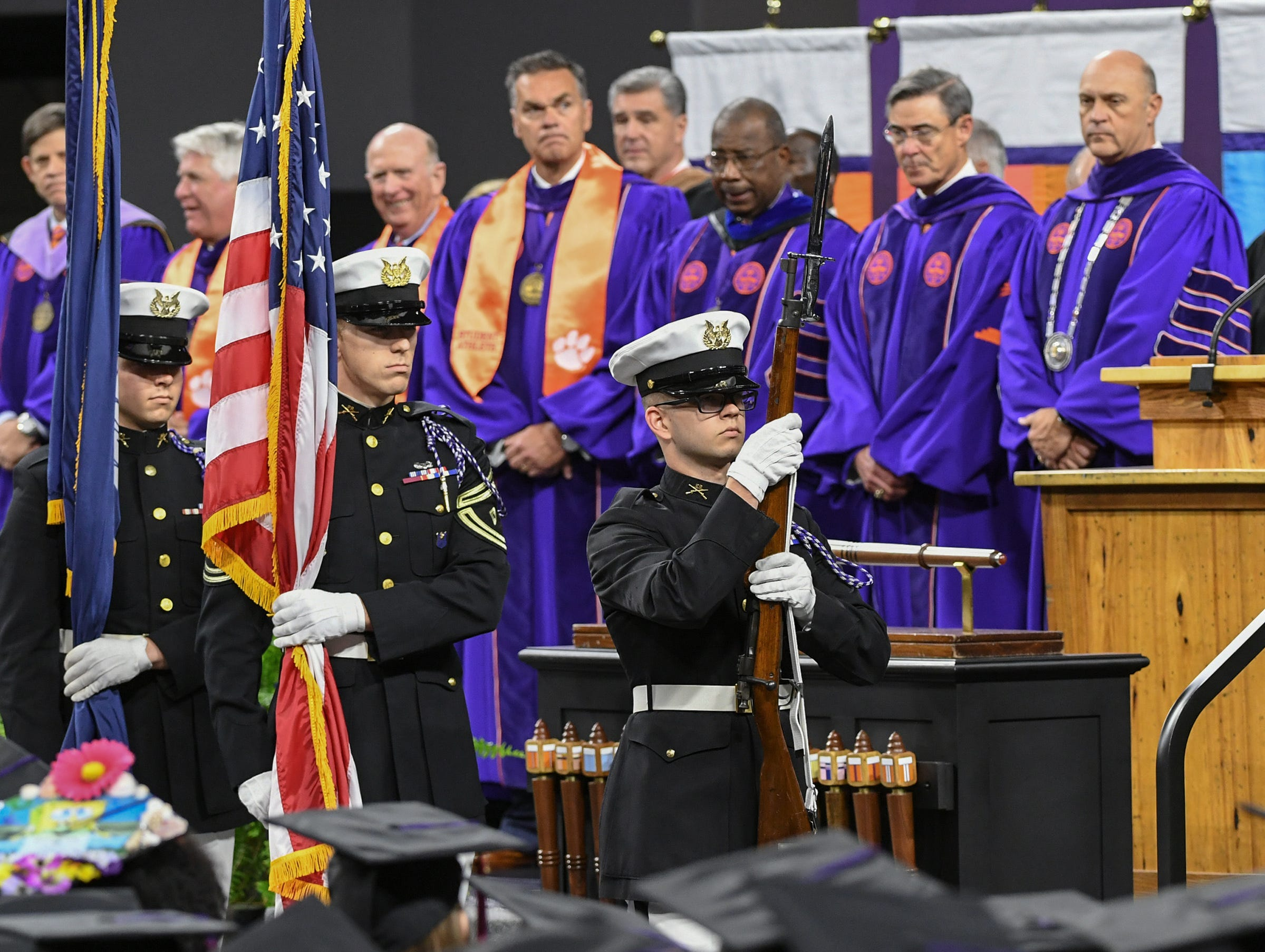 Clemson University Pershing Rifles C4 post colors, walking by the Board of Trustees for the National Anthem during Clemson University commencement ceremonies in Littlejohn Coliseum in Clemson Friday, May 10, 2019.