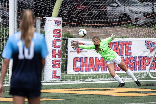 Southside Christian gets the ball past Oceanside Collegiate goalkeeper Britton Logan for a goal during the Class AA championship at Irmo High School in Columbia, Friday, May 10, 2019. Southside won 6-1.