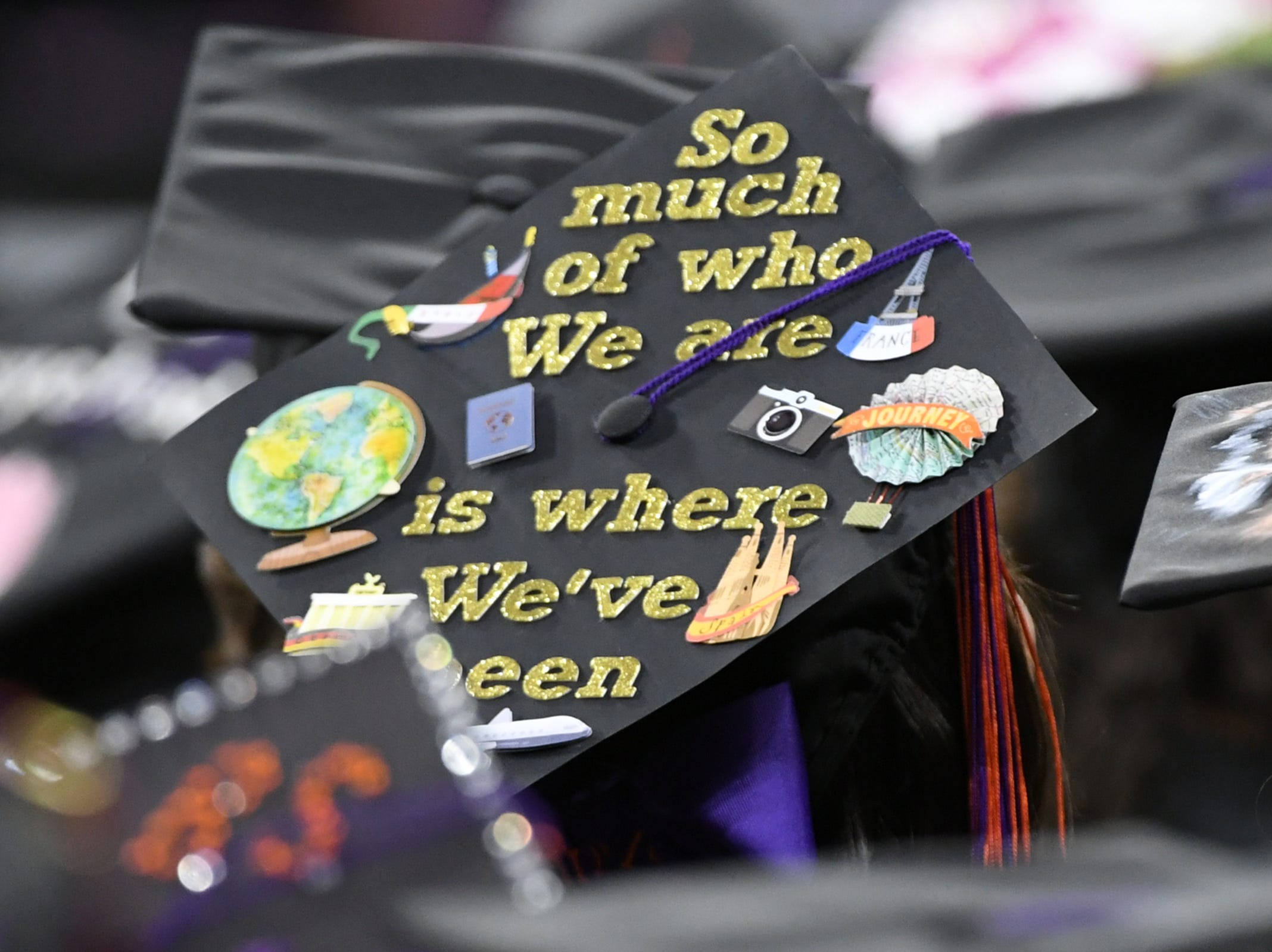 """A cap with words """"So much of who we are is where we've been"""" during Clemson University commencement ceremonies in Littlejohn Coliseum in Clemson Friday, May 10, 2019."""