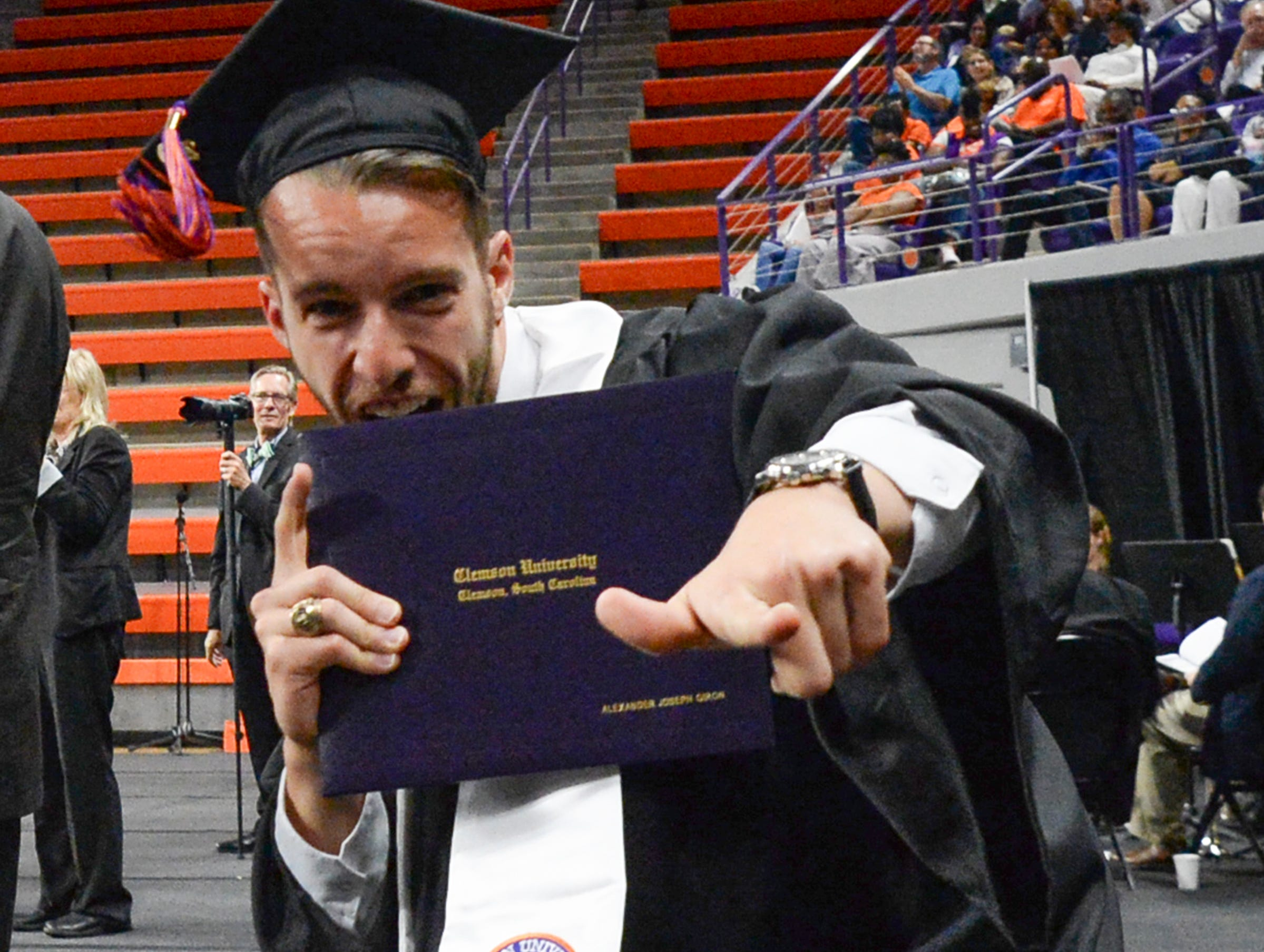 Alexander Giron reacts after getting his diploma during Clemson University commencement ceremonies in Littlejohn Coliseum in Clemson Friday, May 10, 2019.