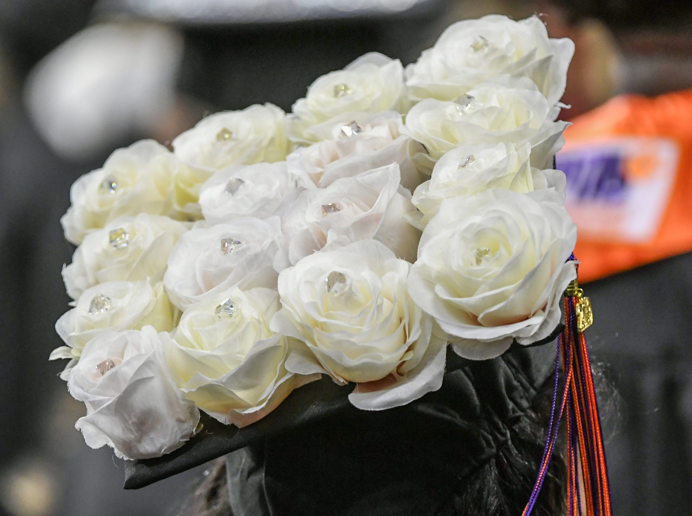 A cap decorated with white roses during Clemson University commencement ceremonies in Littlejohn Coliseum in Clemson Friday, May 10, 2019.