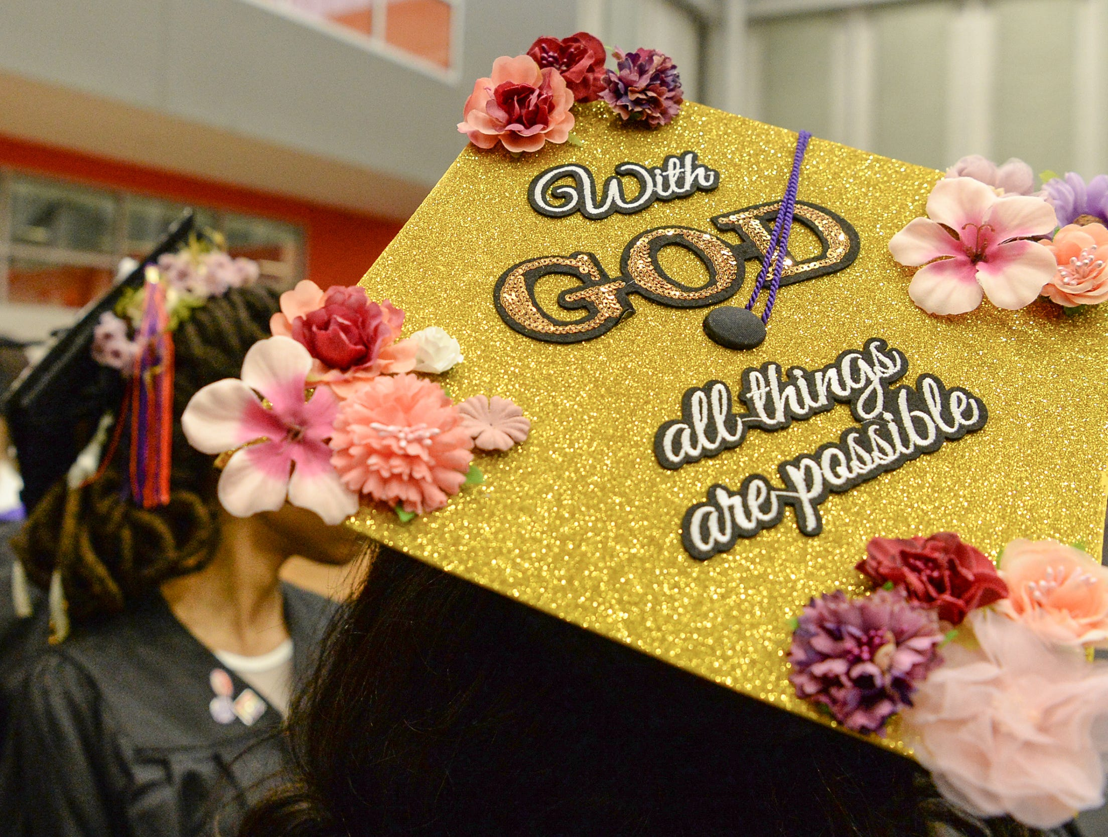 """Kirsten Curry wears a cap """"With God all things are possible"""" written on it during Clemson University commencement ceremonies in Littlejohn Coliseum in Clemson Friday, May 10, 2019."""