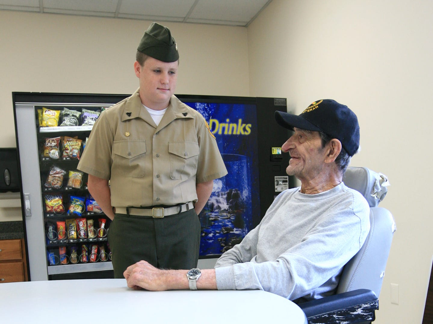 """cap: Ken Ruinard Independent MailAnderson County Young Marines Cpl. Logan Lange, 14, of Honea Path meets Bobby Triplett, retired U.S. Air Force Vietnam Veteran at the Richard Campbell Veterans Nursing Home in Anderson.  """"Thank you for all you did for our country,"""" said Logan to the veteran, who was a Sergeant Major when he retired in 2010."""