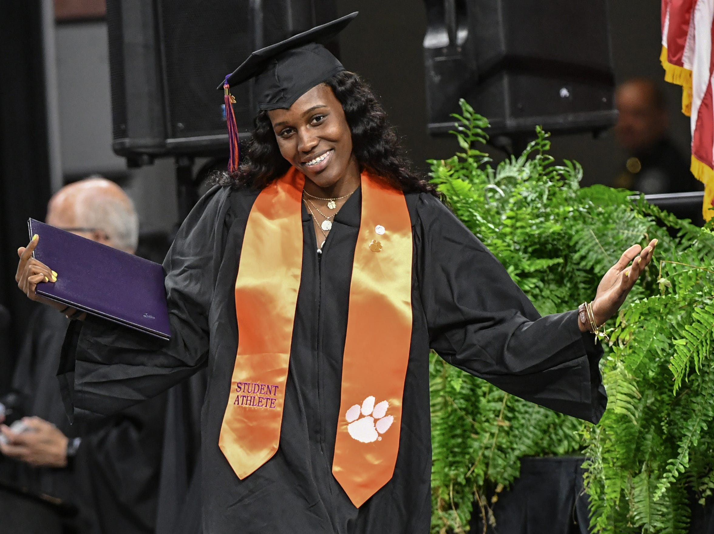 Aliyah Collier, former women's basketball, reacts after getting a bachelor of science in parks, recreation, tourism, management during Clemson University commencement ceremonies in Littlejohn Coliseum in Clemson Friday, May 10, 2019.