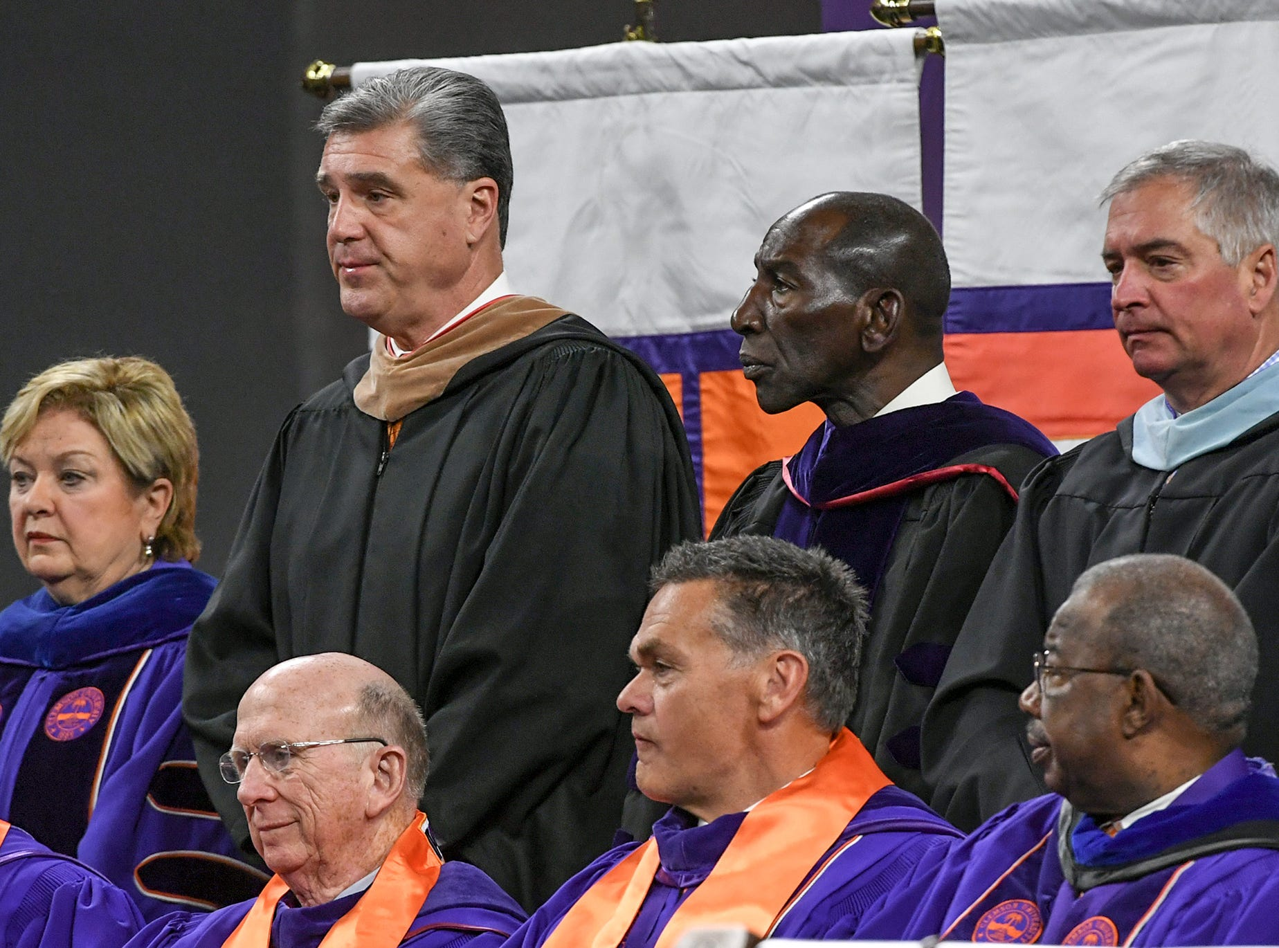 Clemson University Board of Trustees members, front from left; John N. (Nicky) McCarter, Jr., David Wilkins, William C. Smith, Jr., and Louis Lynn, are joined by top row from left; Vice President for Student Affairs Almeda Jacks, Athletic Director Dan Radakovich, Chief Diversity Officer and Special Assistant to the President Lee A. Gill during Clemson University commencement ceremonies in Littlejohn Coliseum in Clemson Friday, May 10, 2019.