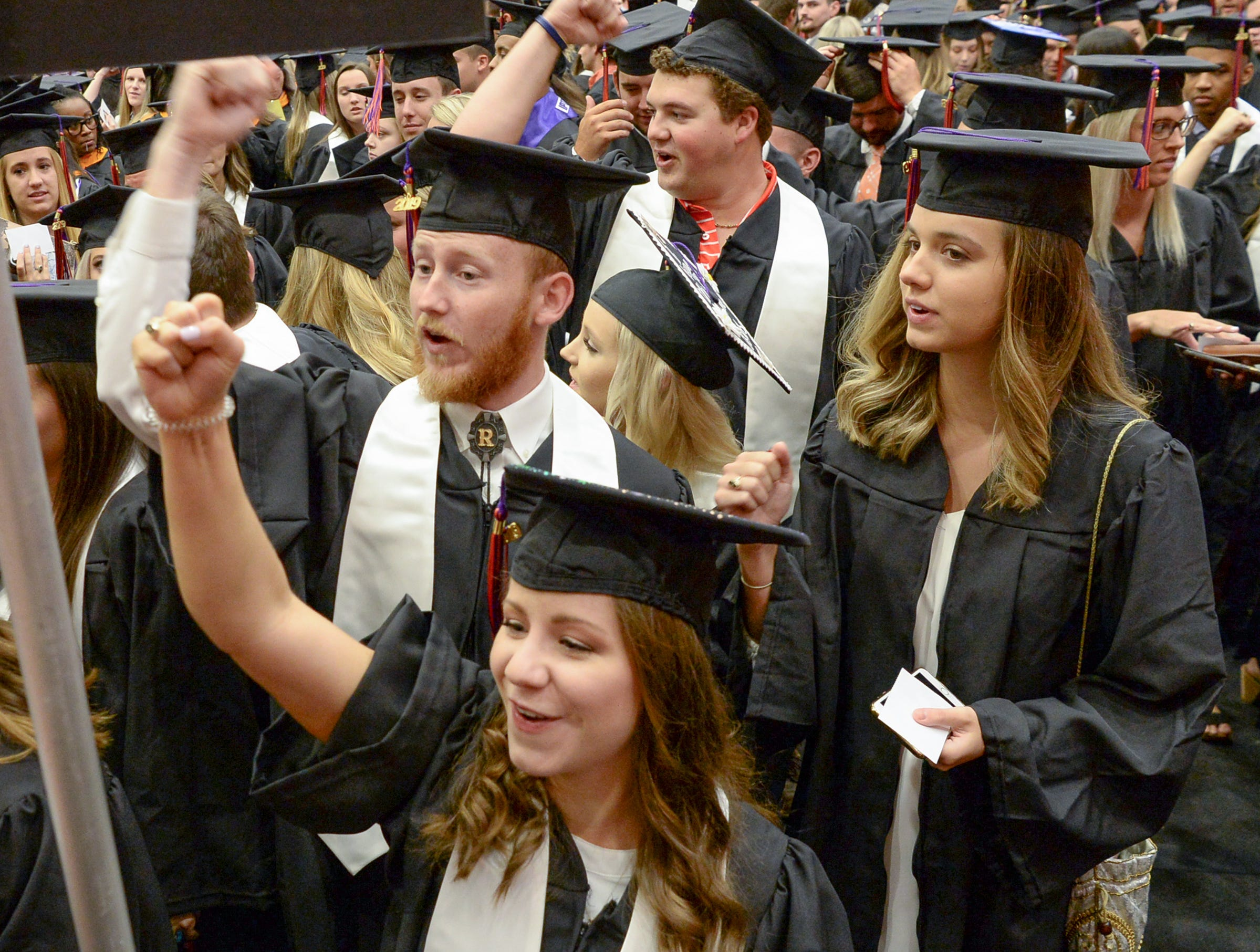Haley Moore of Aiken joins in a cadence count cheer with friends before Clemson University commencement ceremonies in Littlejohn Coliseum in Clemson Friday, May 10, 2019.