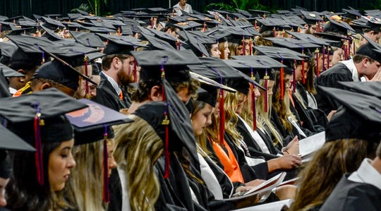 "Students observe a moment of silence with Clemson President Jim Clements as he awarded a degree in Enviromental and Natural Resources posthumously to William ""Billy"" L. Gallien of Clover, S.C., during Clemson University commencement ceremonies in Littlejohn Coliseum in Clemson Friday, May 10, 2019. Gallien died after driving a 2006 Ford pickup truck May 1 into the rear of a dump truck that was stopped in one of the I-85 northbound lanes in Spartanburg County."