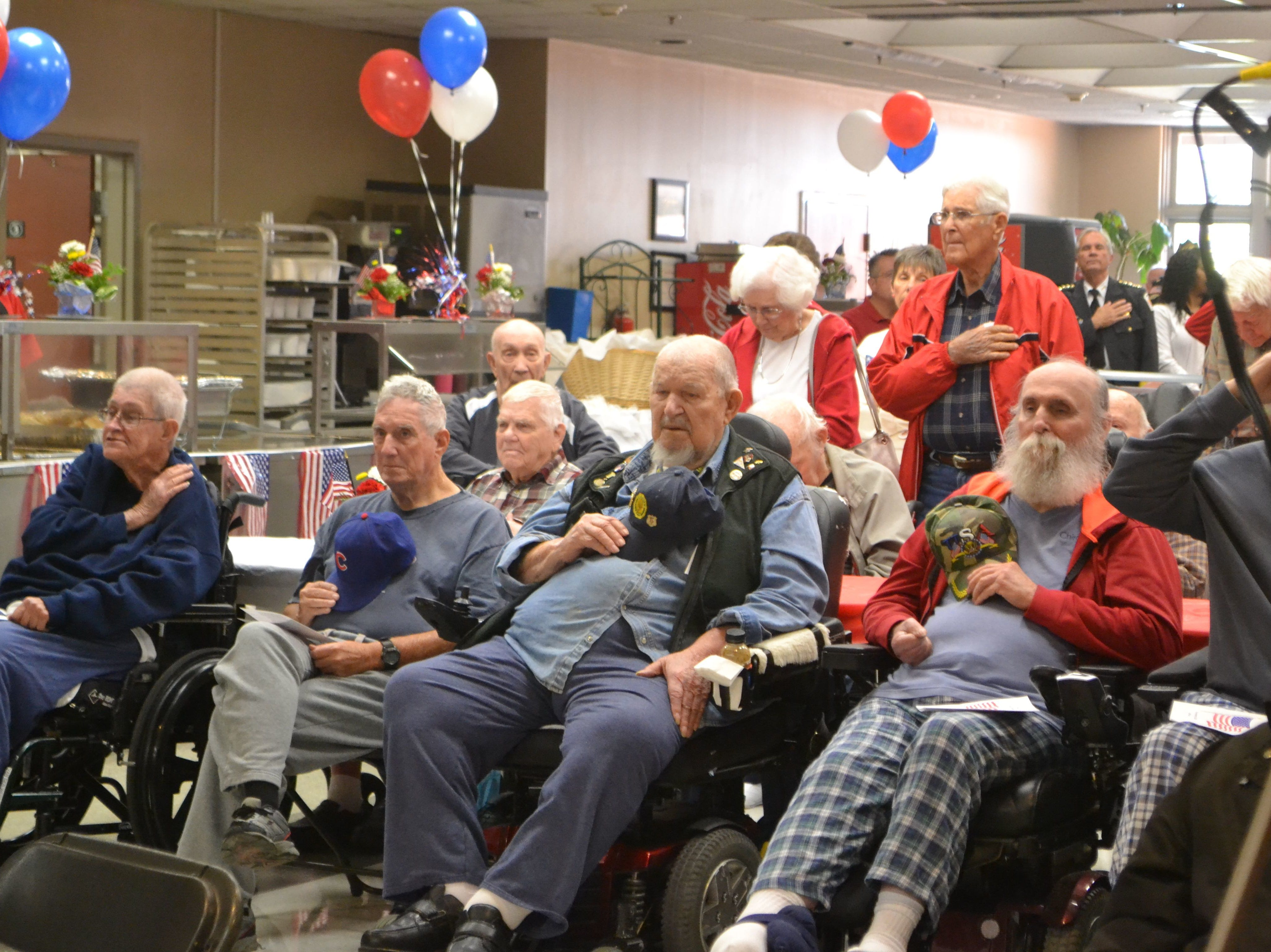 HMR receives nearly $36.5 million annually from the state to operate Victory House and the Richard M. Campbell Veterans Nursing Home, pictured, in Anderson County. Residents in the Richard M. Campbell Veterans Nursing Home salute or place their hands over their hearts as taps plays during a ceremony.