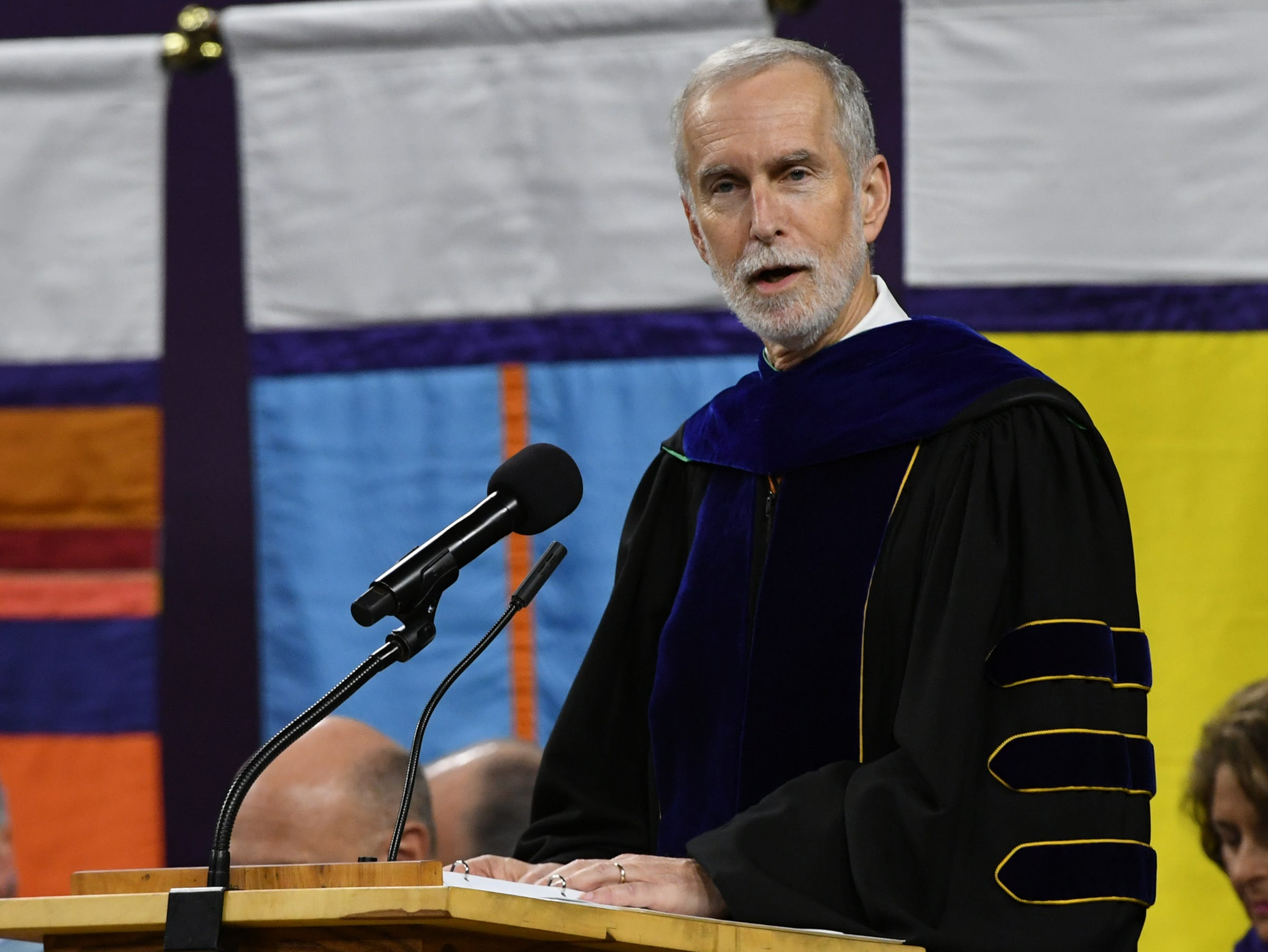 Bob Jones, Executive Vice President for Academic Affairs, recognizes the deans of colleges during Clemson University commencement ceremonies in Littlejohn Coliseum in Clemson Friday, May 10, 2019.