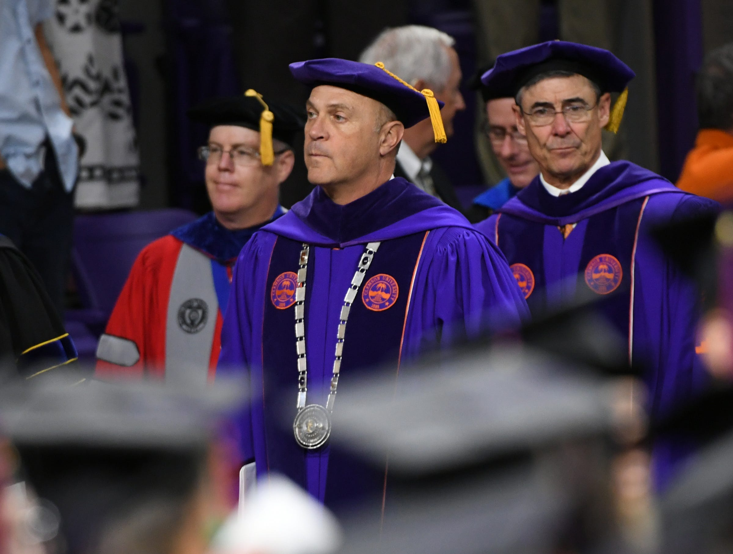 President Jim Clements leads board of trustees during Clemson University commencement ceremonies in Littlejohn Coliseum in Clemson Friday, May 10, 2019.