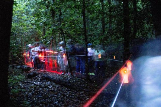 A crowd gathers along the Fireflies Trail inside Congaree National Park to watch synchronous fireflies Sunday May 20, 2018, in Columbia, SC. The rare phenomenon of synchronization lasts been two to three weeks during the year.