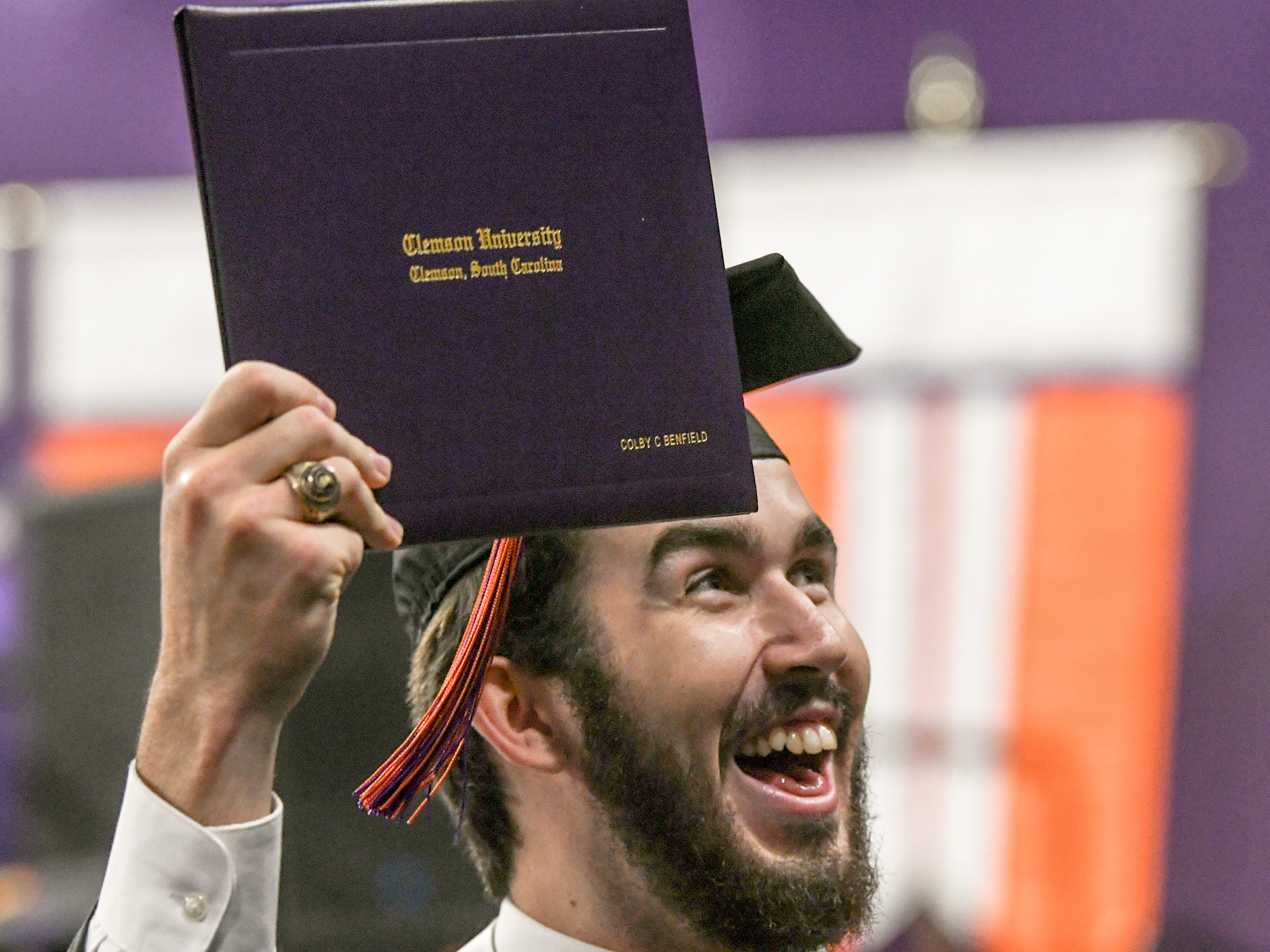 Colby Benfield of Inland Land, S.C. holds up his Bachelor of Science degree in Forest Resource Management during Clemson University commencement ceremonies in Littlejohn Coliseum in Clemson Friday, May 10, 2019.