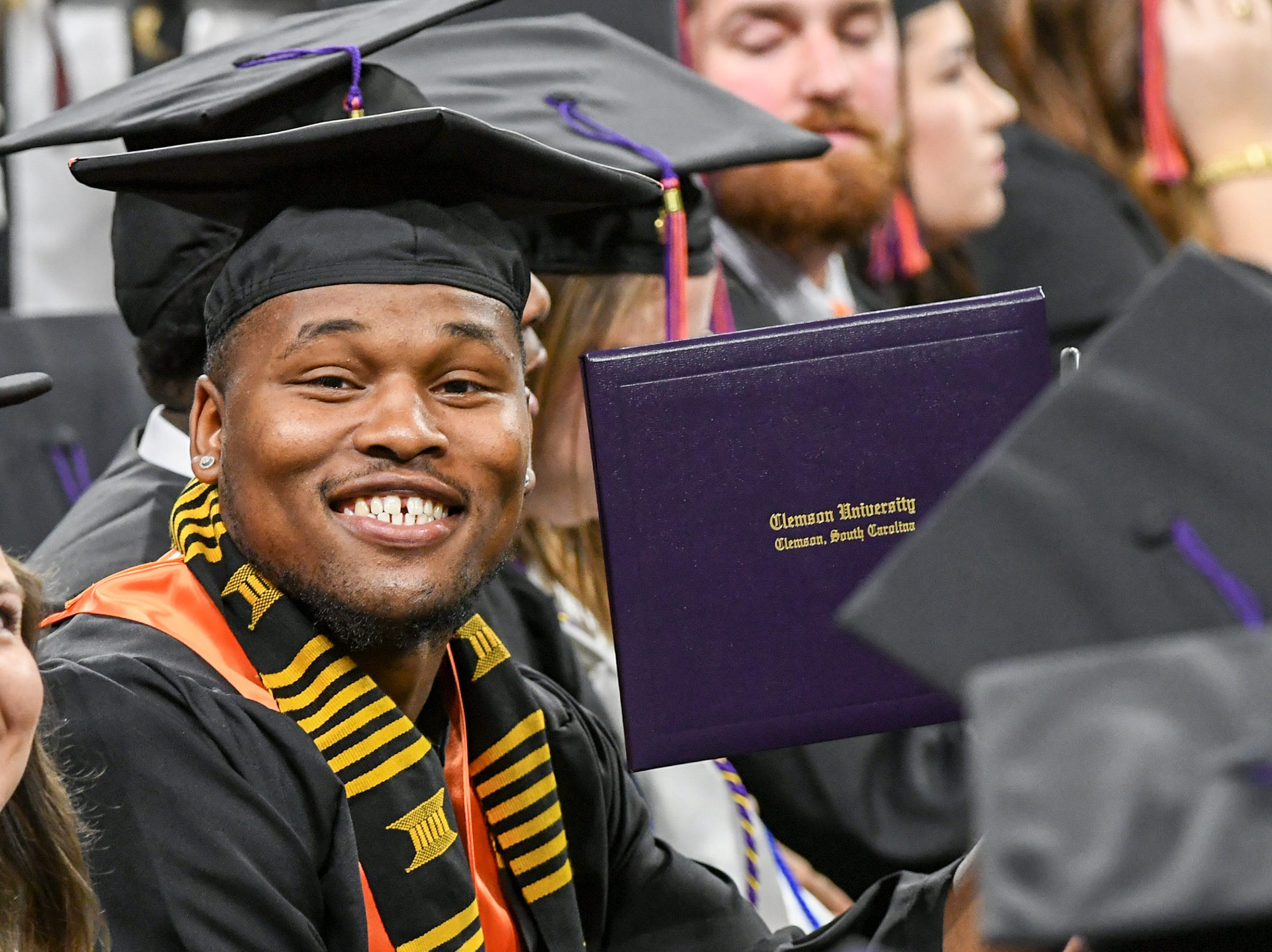 Shaq Smith gets his bachelor of science in parks, recreation, tourism, management smiles during Clemson University commencement ceremonies in Littlejohn Coliseum in Clemson Friday, May 10, 2019.