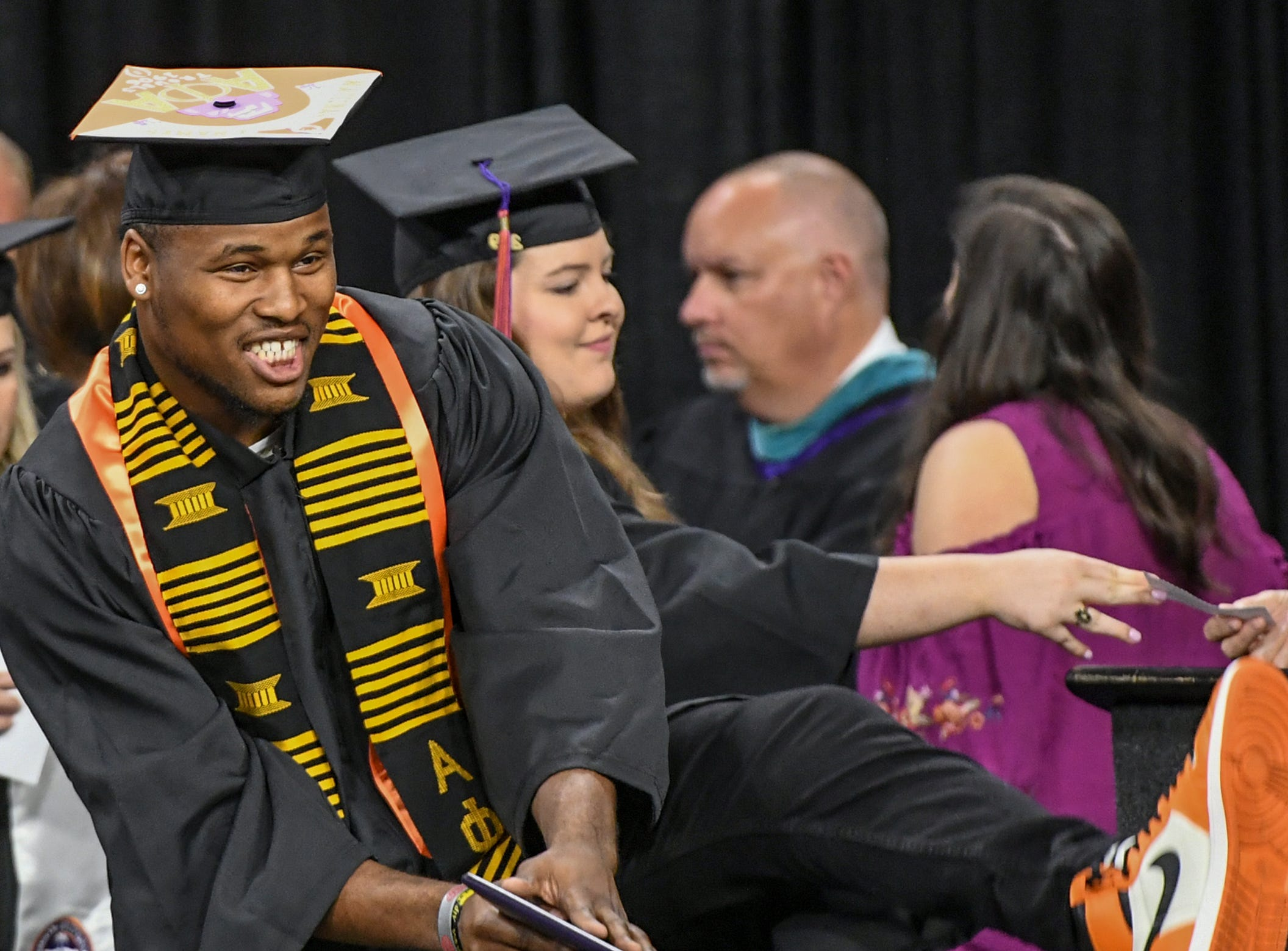 Shaq Smith gets his bachelor of science in parks, recreation, tourism, management during Clemson University commencement ceremonies in Littlejohn Coliseum in Clemson Friday, May 10, 2019.