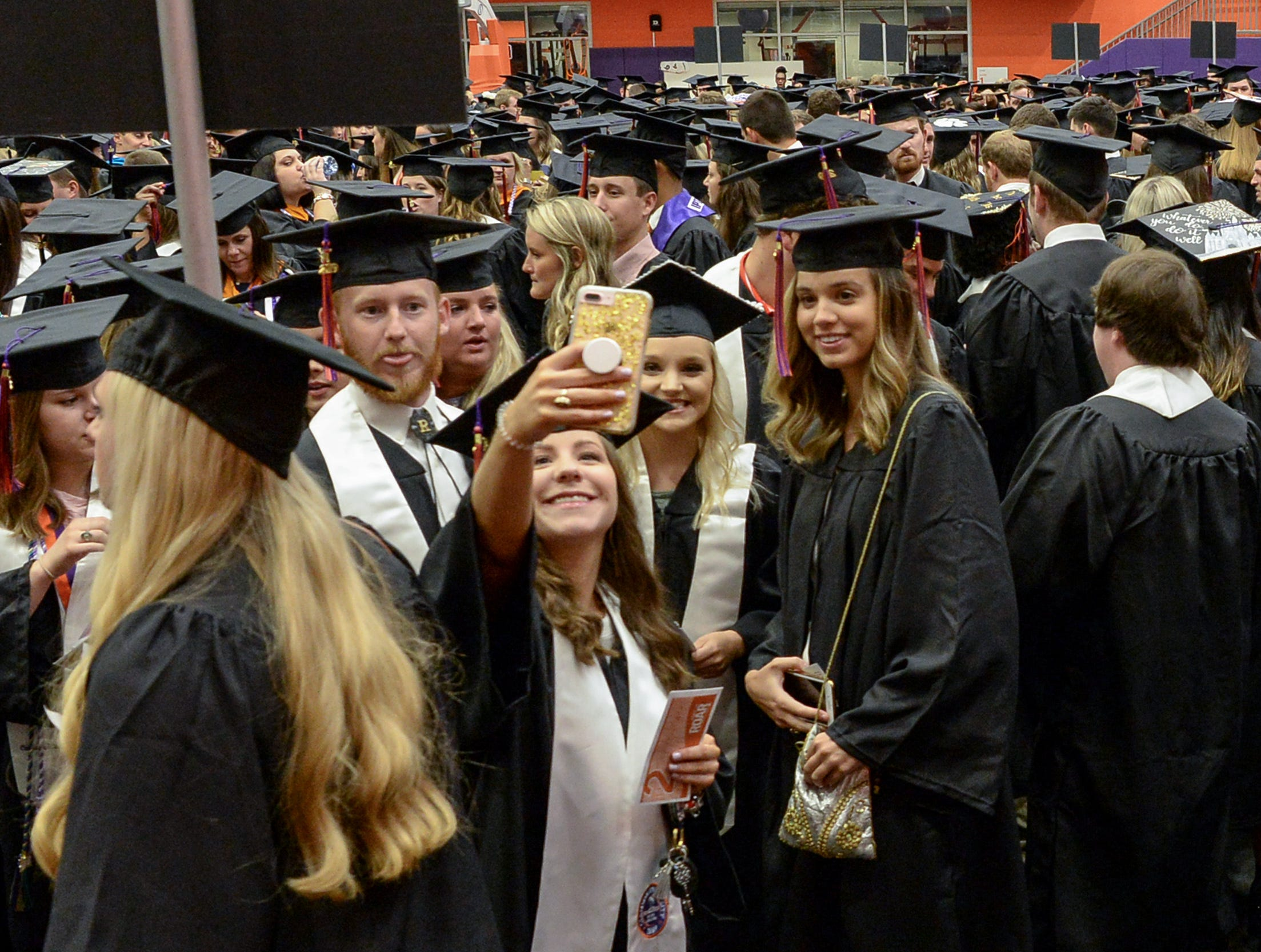 Haley Moore of Aiken gets a selfie photo with friends before  Clemson University commencement ceremonies in Littlejohn Coliseum in Clemson Friday, May 10, 2019.
