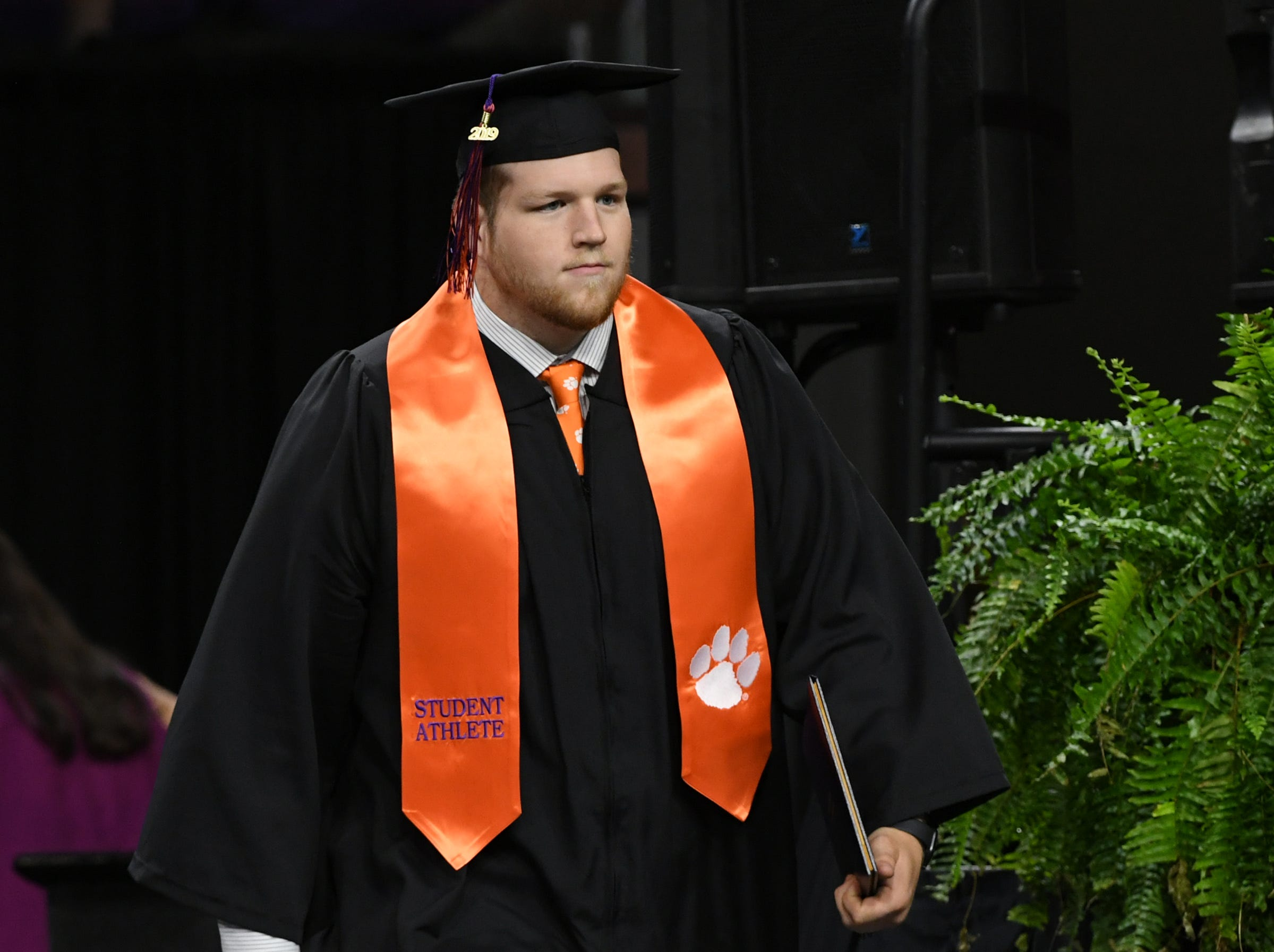 Logan Tisch gets his bachelor of science in plant and environmental sciences during Clemson University commencement ceremonies in Littlejohn Coliseum in Clemson Friday, May 10, 2019.