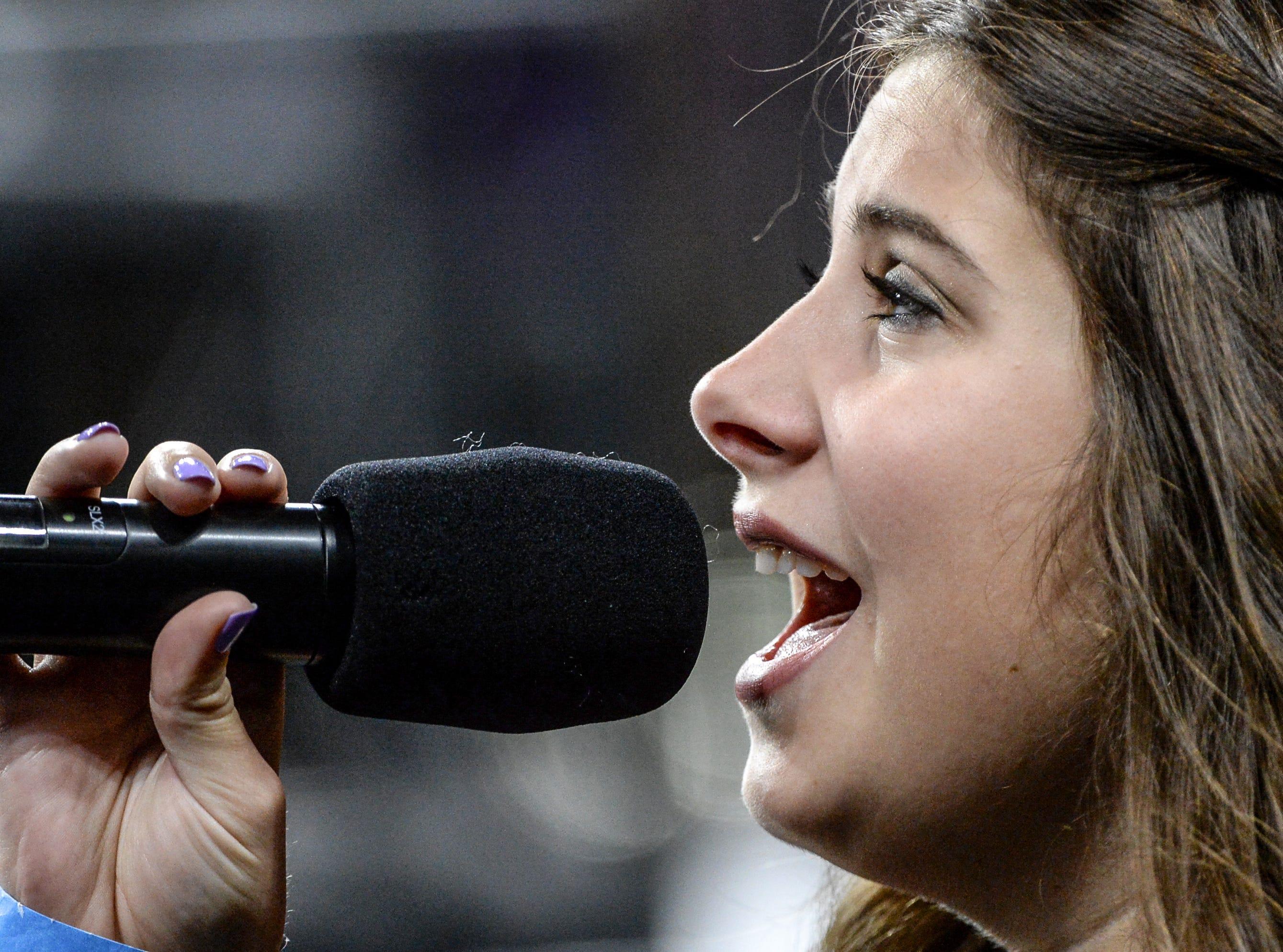 Graduate Emma Baker sings the National Anthem during Clemson University commencement ceremonies in Littlejohn Coliseum in Clemson Friday, May 10, 2019.