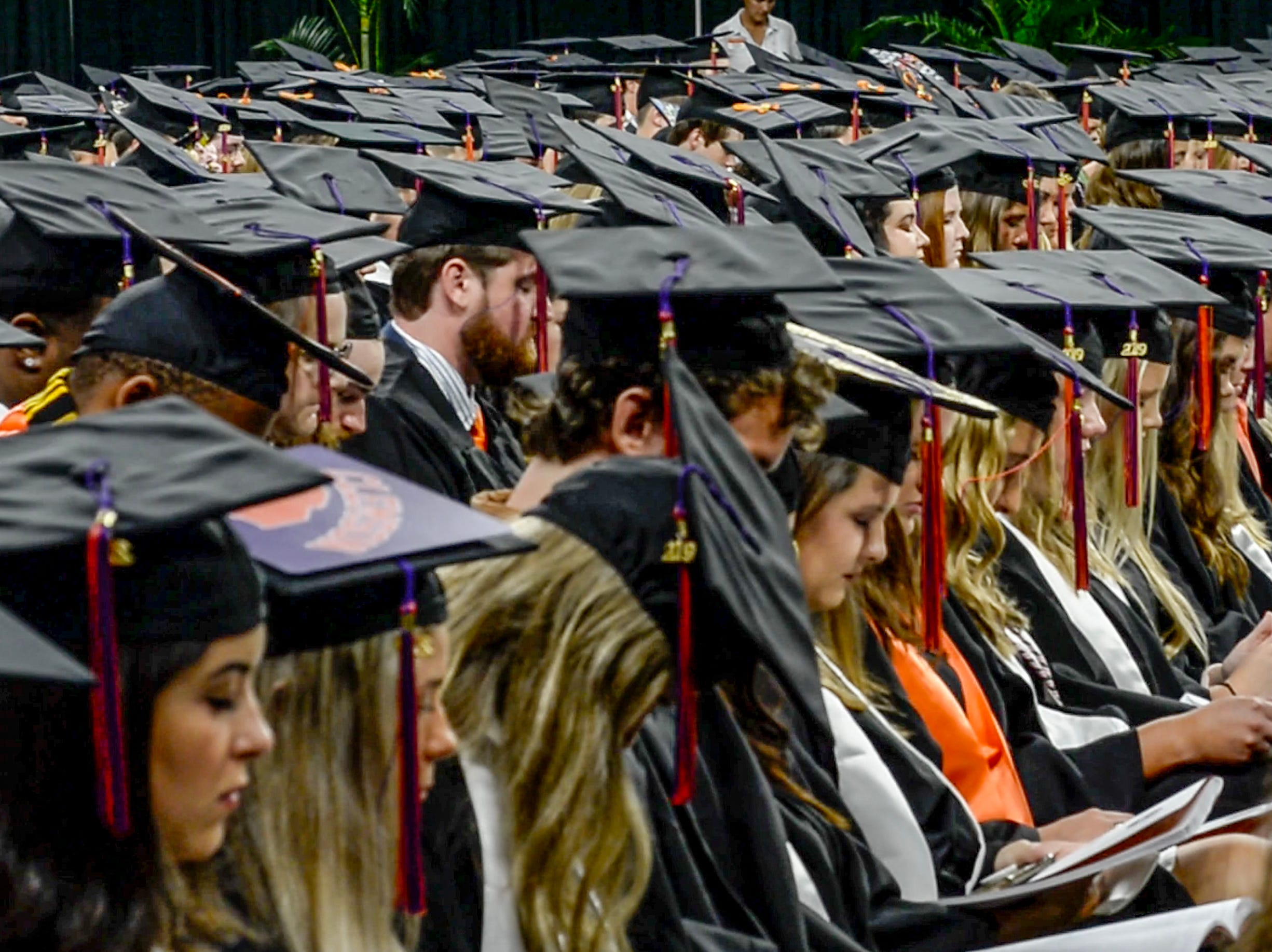 """Students observe a moment of silence with Clemson President Jim Clements as he awarded a degree in Enviromental and Natural Resources posthumously to William """"Billy"""" L. Gallien of Clover, S.C., during Clemson University commencement ceremonies in Littlejohn Coliseum in Clemson Friday, May 10, 2019. Gallien died after driving a 2006 Ford pickup truck May 1 into the rear of a dump truck that was stopped in one of the I-85 northbound lanes in Spartanburg County."""