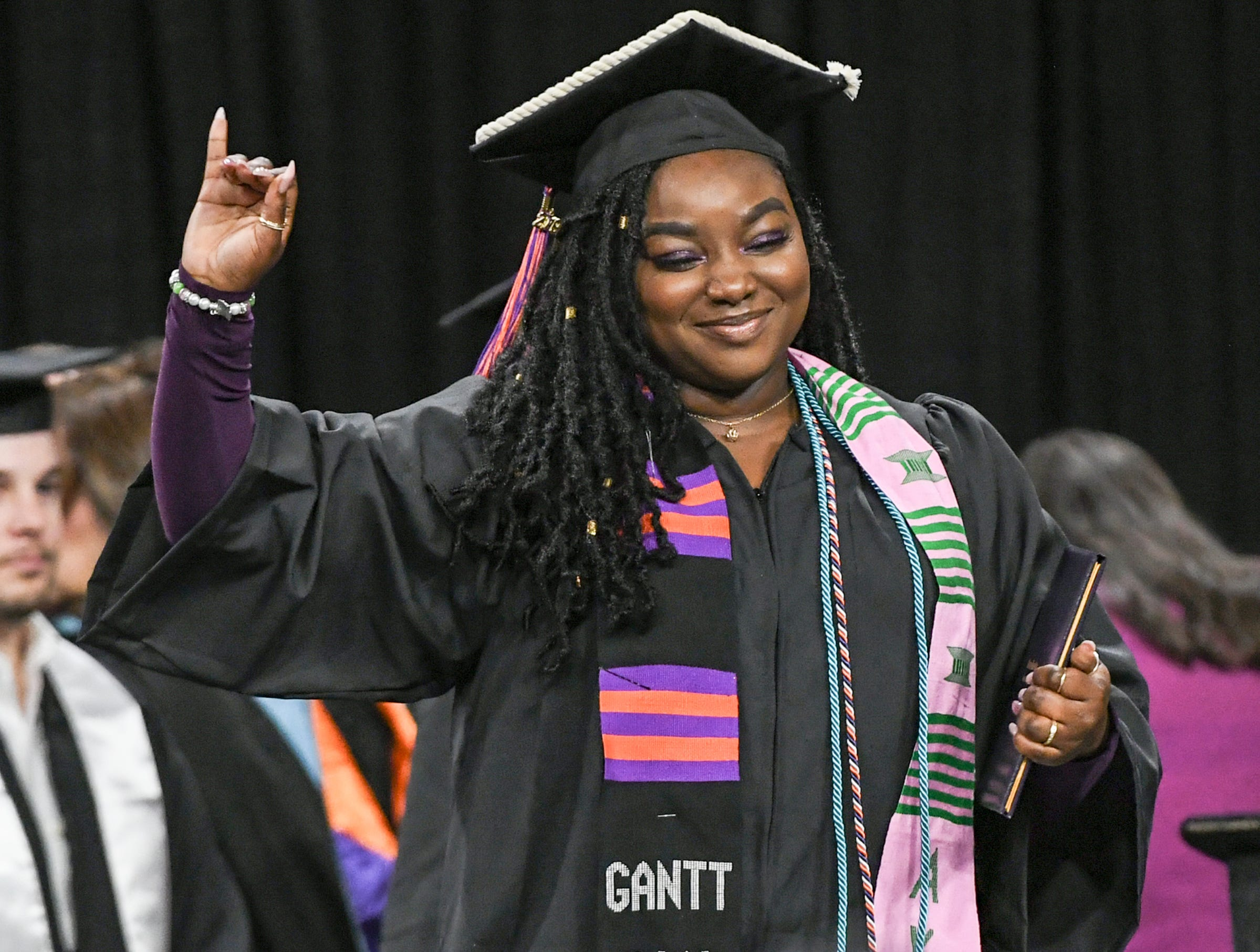 Ty' Lisa J. Johnson reacts getting her Bachelor of Arts in Psychology during Clemson University commencement ceremonies in Littlejohn Coliseum in Clemson Friday, May 10, 2019.