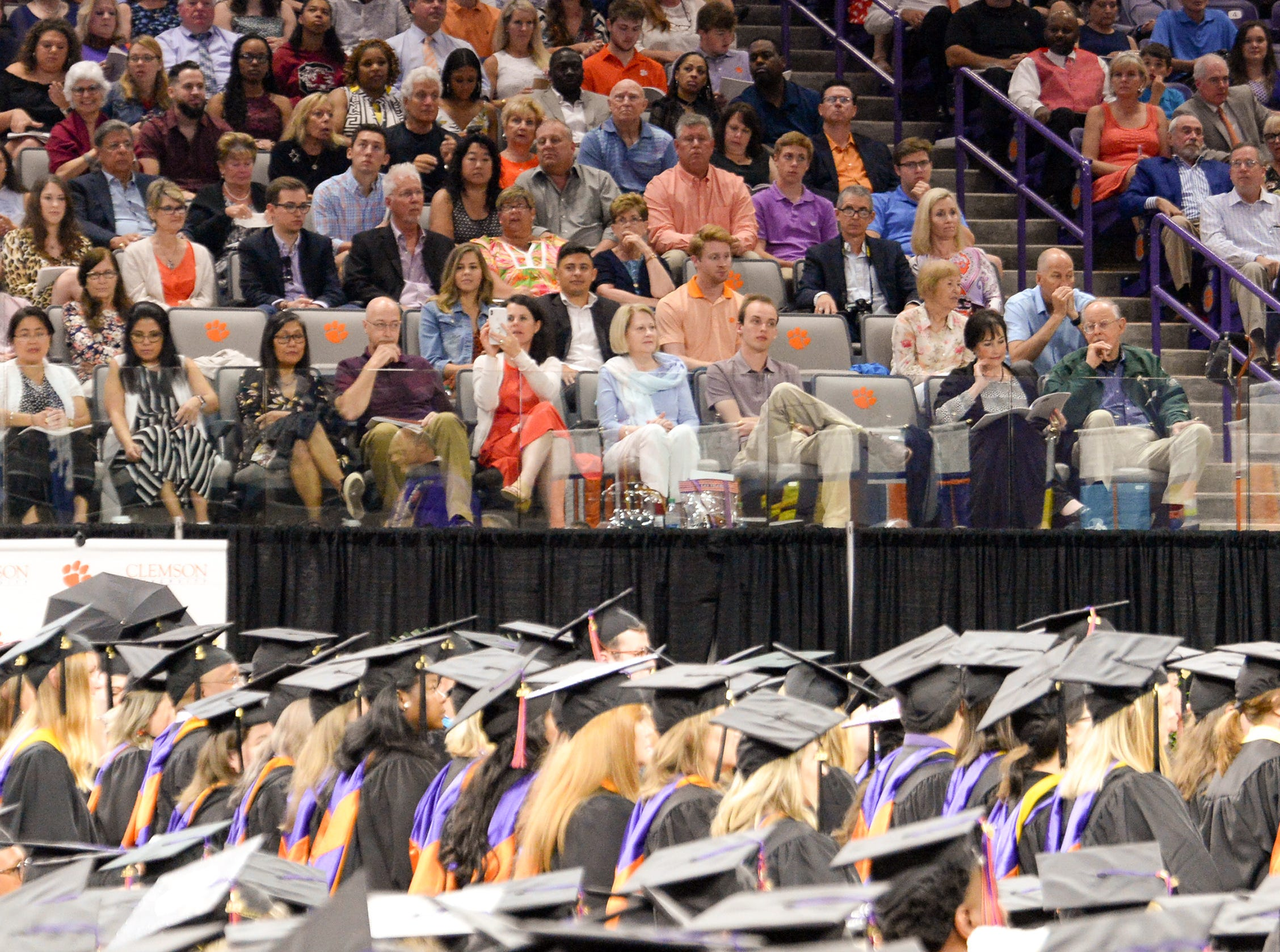 Visitors sit in the stands during Clemson University commencement ceremonies in Littlejohn Coliseum in Clemson Friday, May 10, 2019.