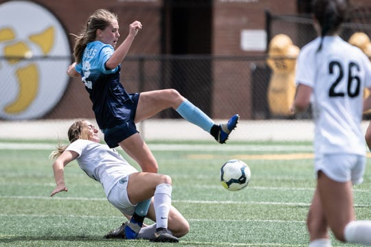 Southside Christian's Ellie Gower and Oceanside's Isabella Pecunes collide during the Class AA championship at Irmo High School in Columbia, Friday, May 10, 2019. Southside won 6-1.