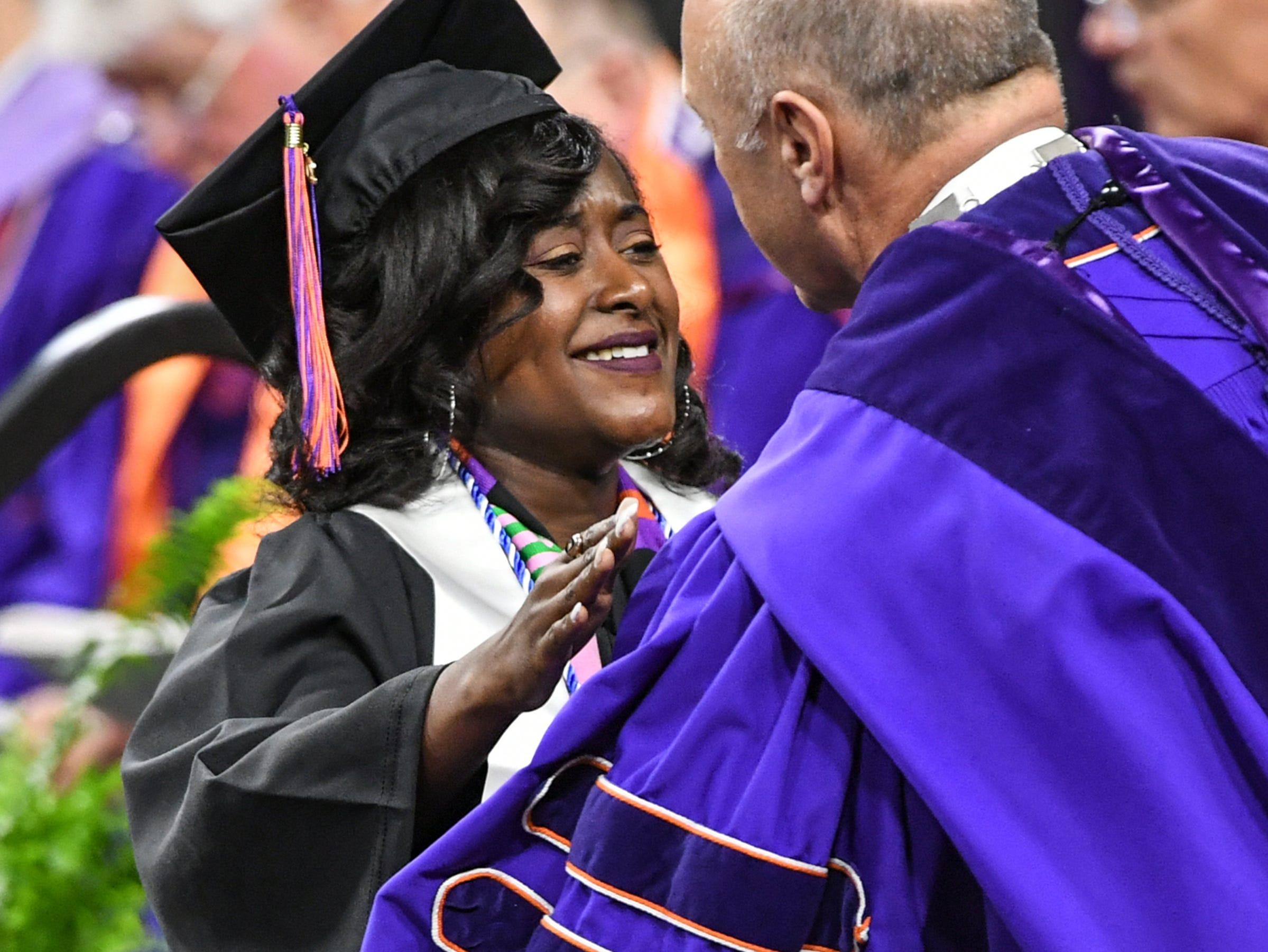 Ja'Tori Myers hugs President Jim Clements after getting her nursing degree during Clemson University commencement ceremonies in Littlejohn Coliseum in Clemson Friday, May 10, 2019.