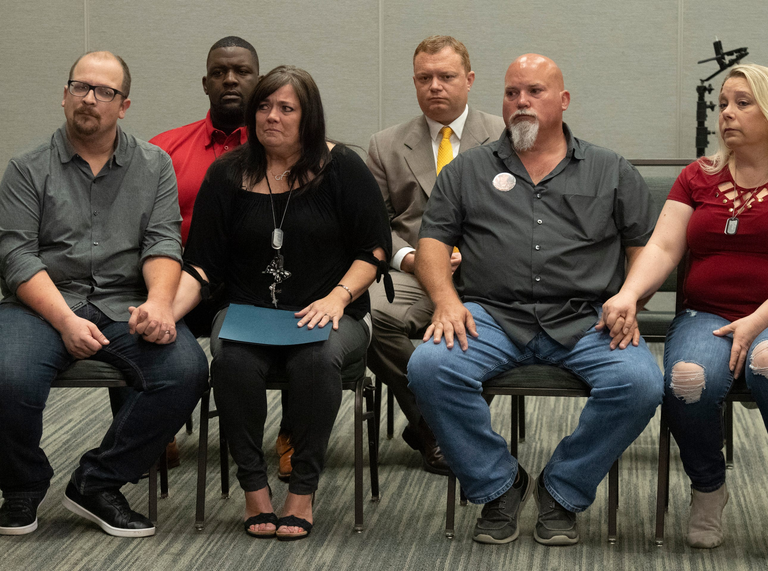 Members of Army veteran Jared Johns' family Gary Bowling (front row from left), Kathy Bowling, Kevin Johns and Kim Grooms attend a press conference at the Greenville Convention Center Friday, May 10, 2019.