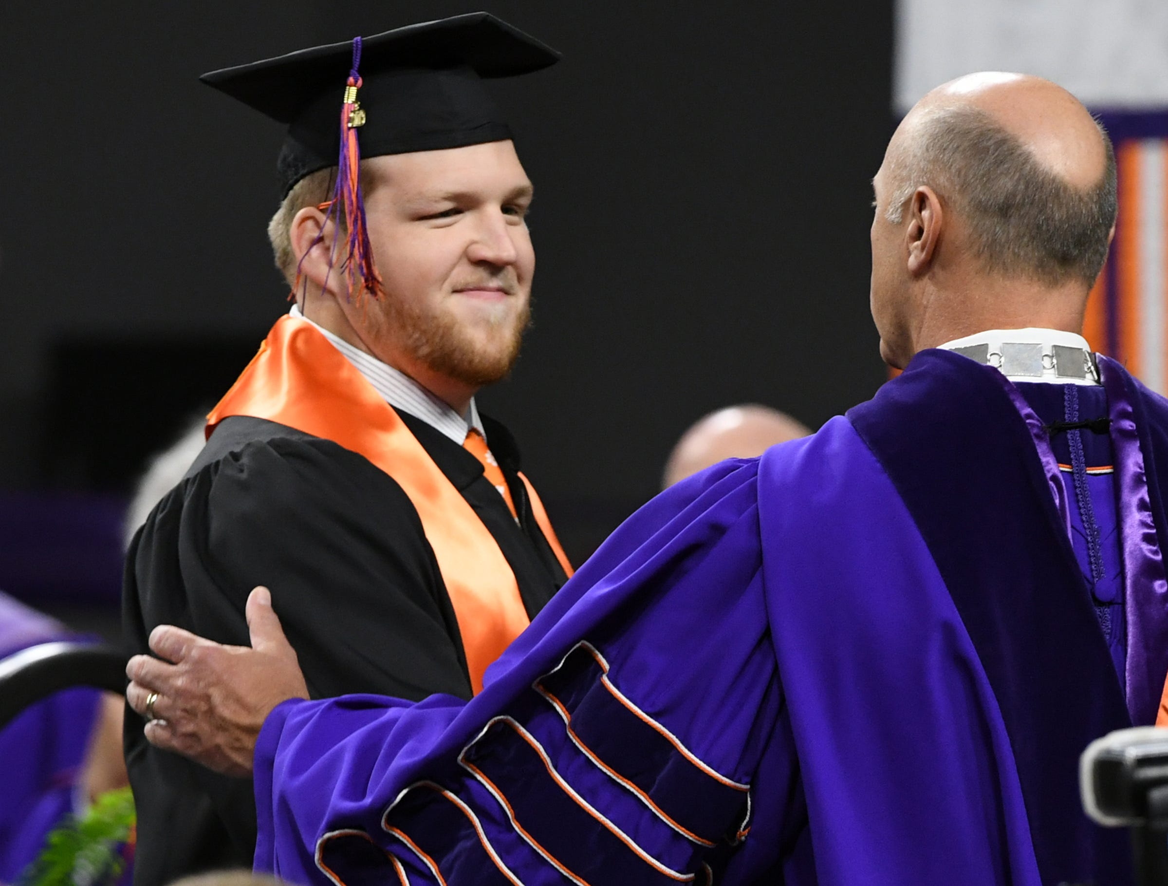 Logan Tisch shakes hands with President Jim Clements as he gets his bachelor of science in plant and environmental sciences during Clemson University commencement ceremonies in Littlejohn Coliseum in Clemson Friday, May 10, 2019.