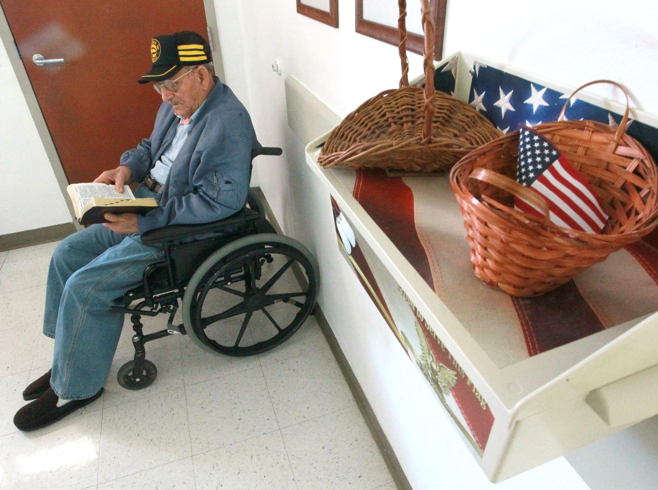 Ernest Butler, 102, of Richard Campbell Veterans Nursing Home in Anderson, reads from the book of Matthew, in The Holy Bible, in his room. Butler was a pastor at Church of Christ in Seneca in 2013.