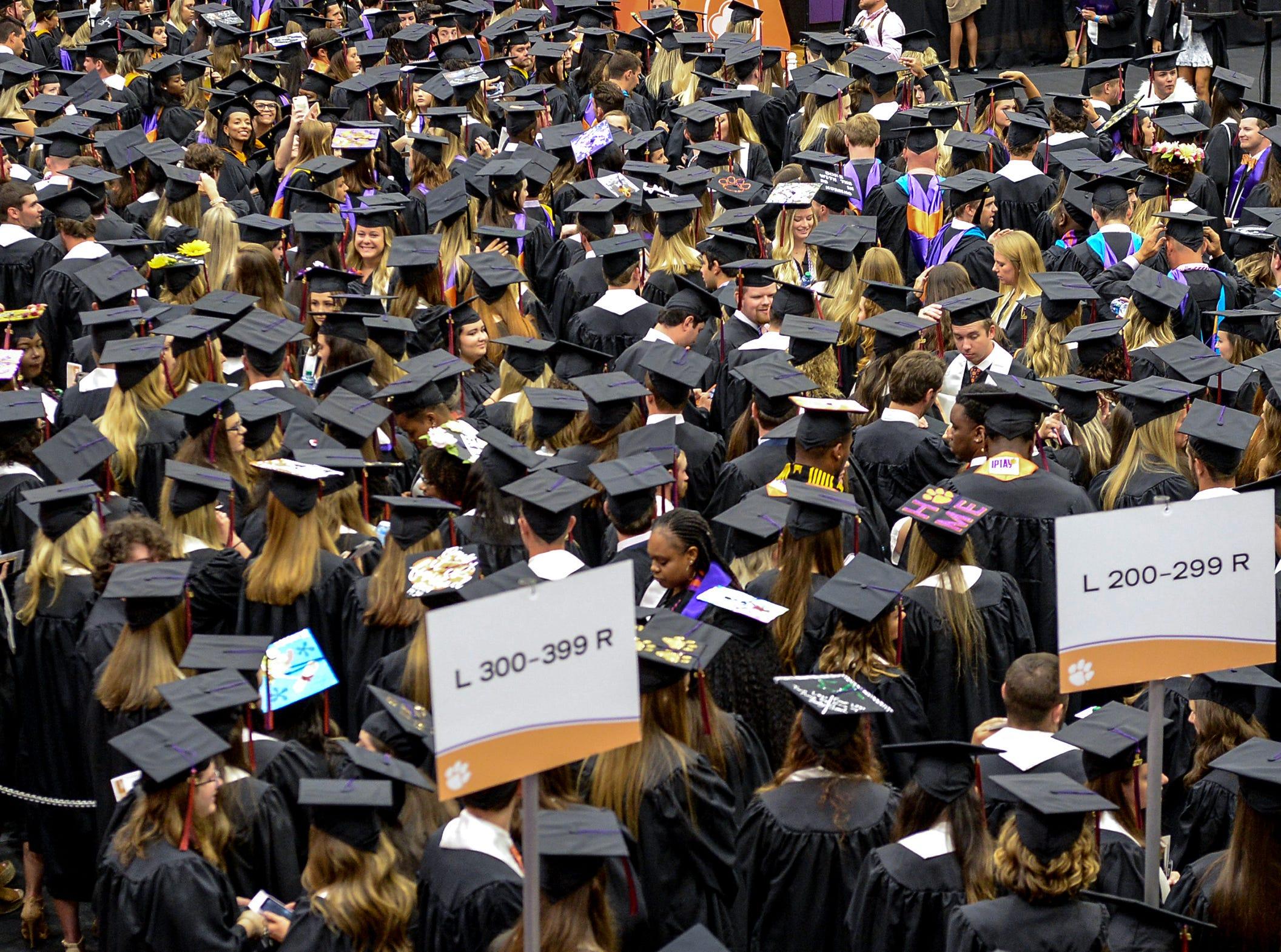 Clemson graduates line up before Clemson University commencement ceremonies in Littlejohn Coliseum in Clemson Friday, May 10, 2019.