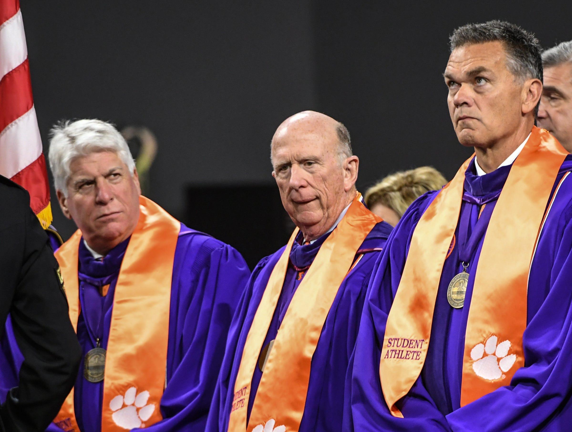 Clemson University Board of Trustees members, from left; John N. (Nicky) McCarter, Jr., David Wilkins, and William C. Smith, Jr., during Clemson University commencement ceremonies in Littlejohn Coliseum in Clemson Friday, May 10, 2019.