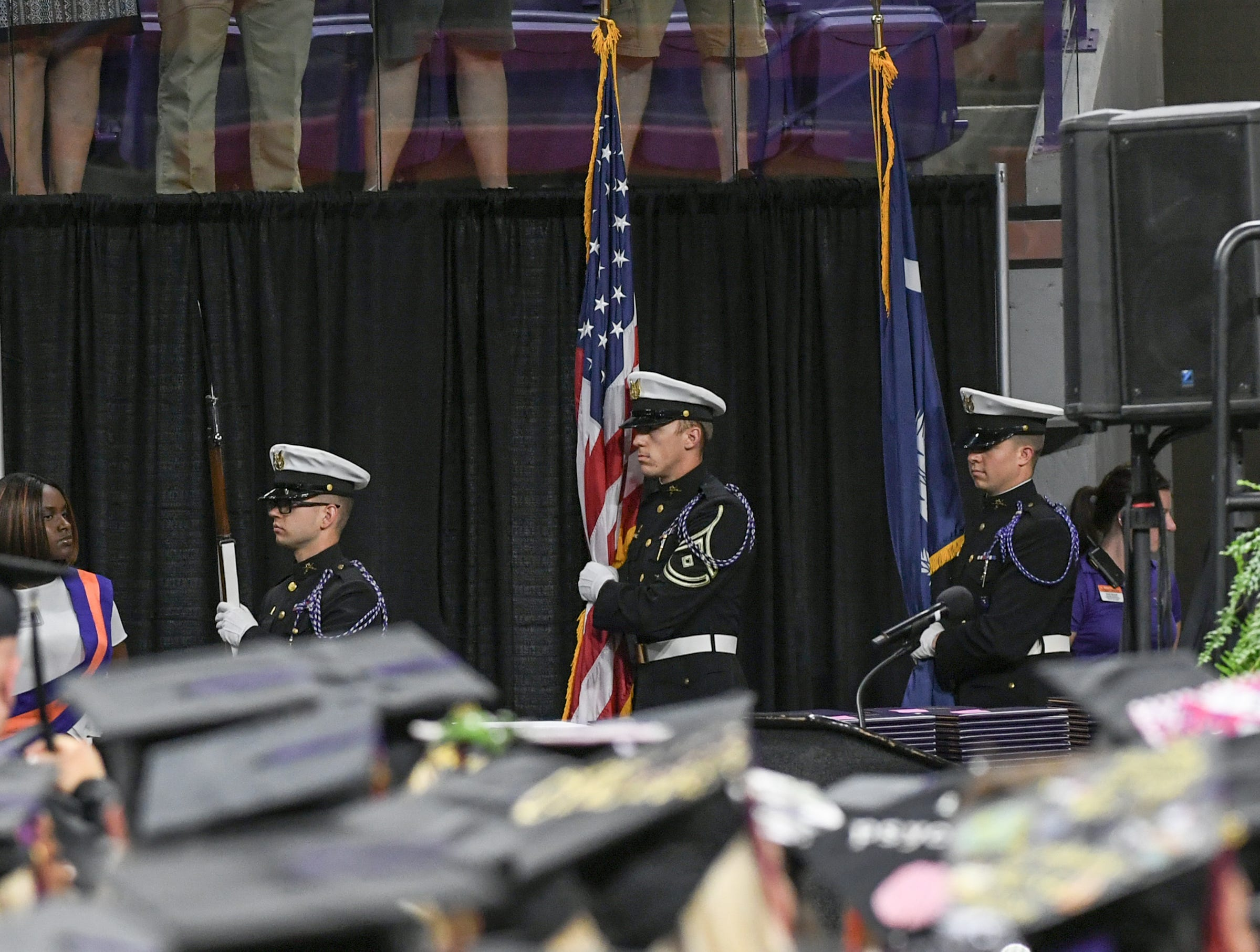 Clemson University Pershing Rifles C4 post colors for the National Anthem during Clemson University commencement ceremonies in Littlejohn Coliseum in Clemson Friday, May 10, 2019.