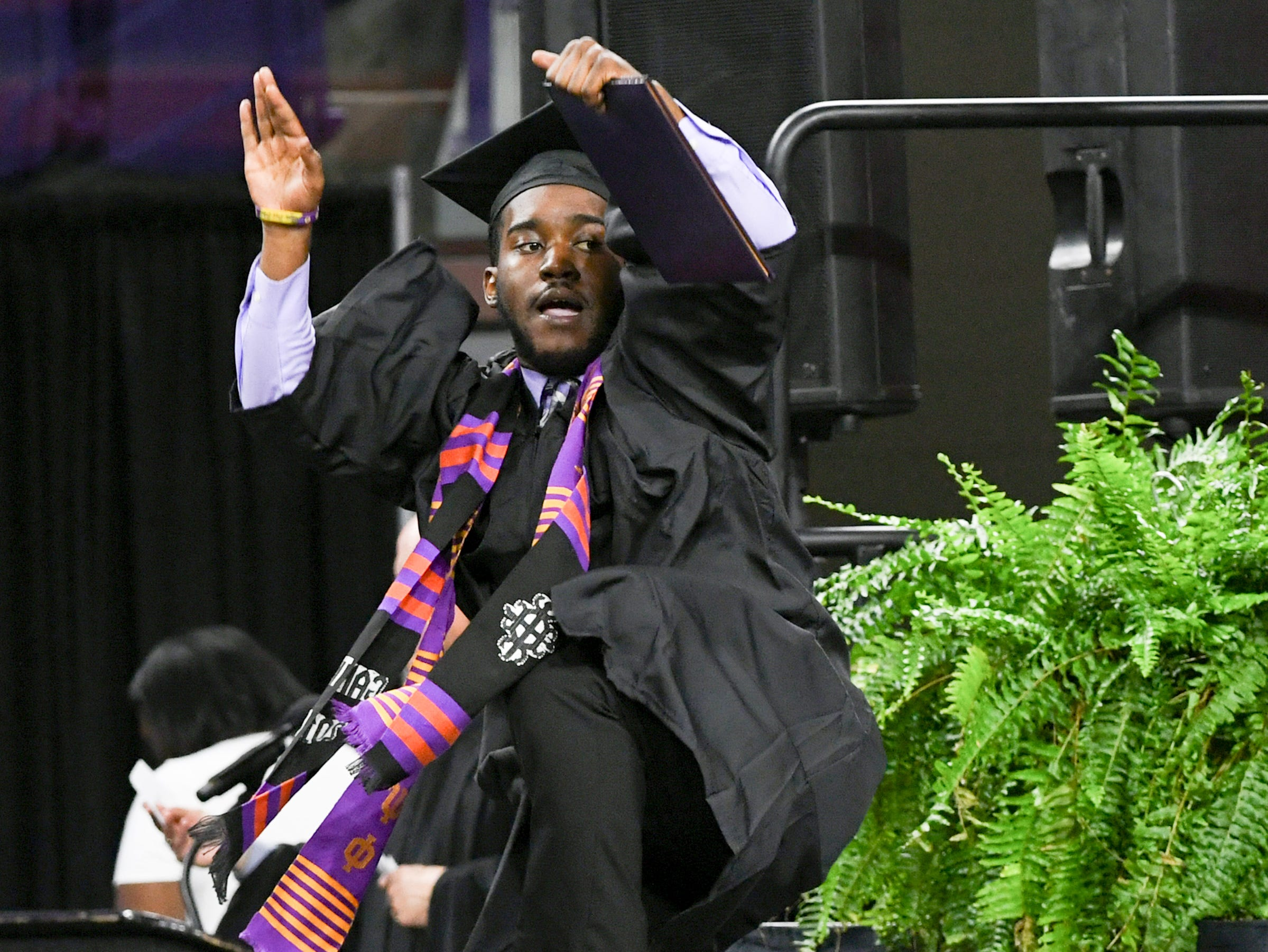 Richard Neely reacts after getting his diploma during Clemson University commencement ceremonies in Littlejohn Coliseum in Clemson Friday, May 10, 2019.