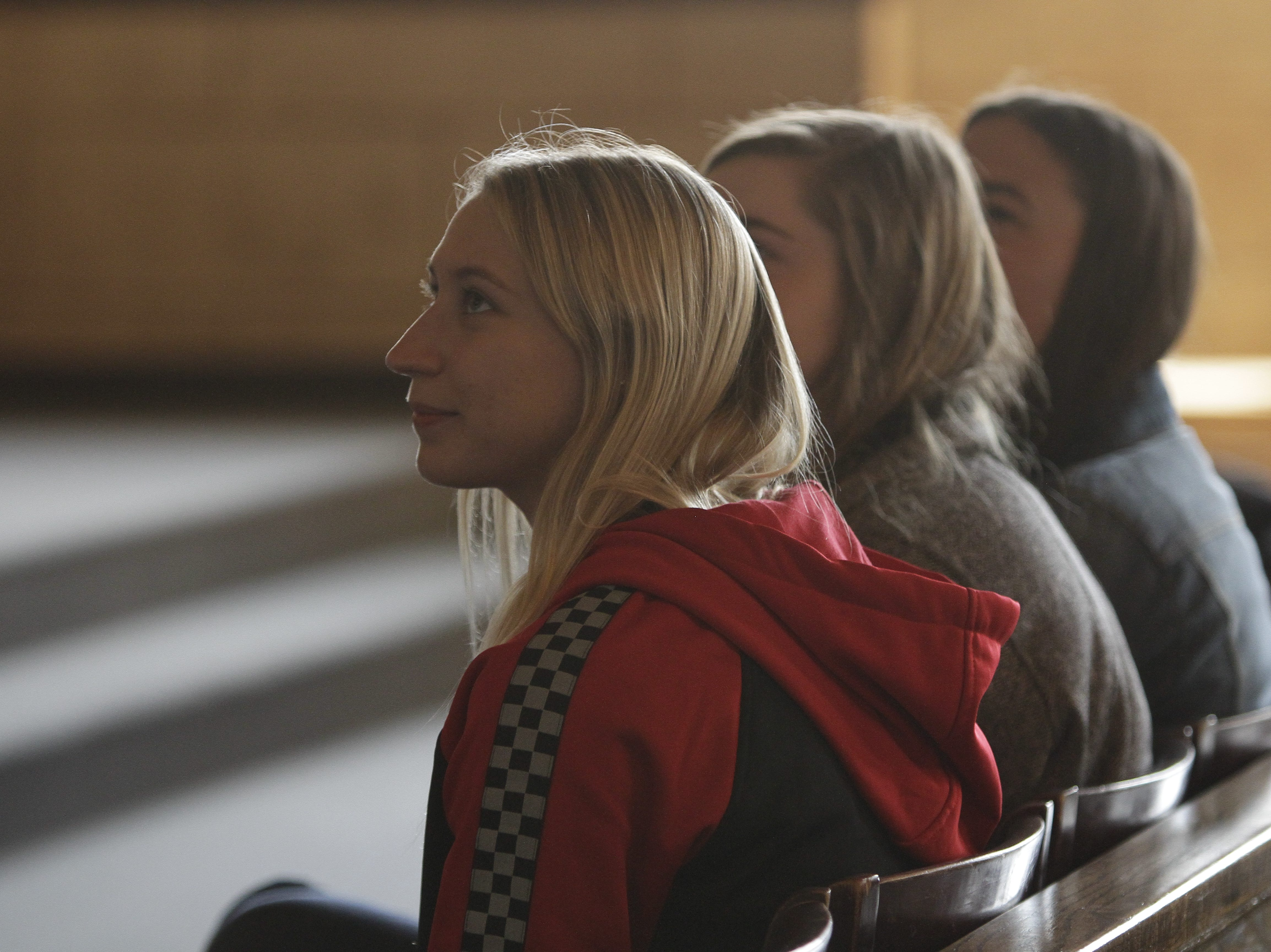 Kenzie Houston,Madison Johnson and Raina Lindseth watching their film as a part of the ceremony.