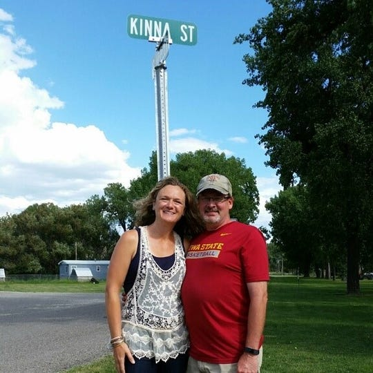 Truitt Kinna and his wife, Vickie, stand on Kinna Street near Simms High School.