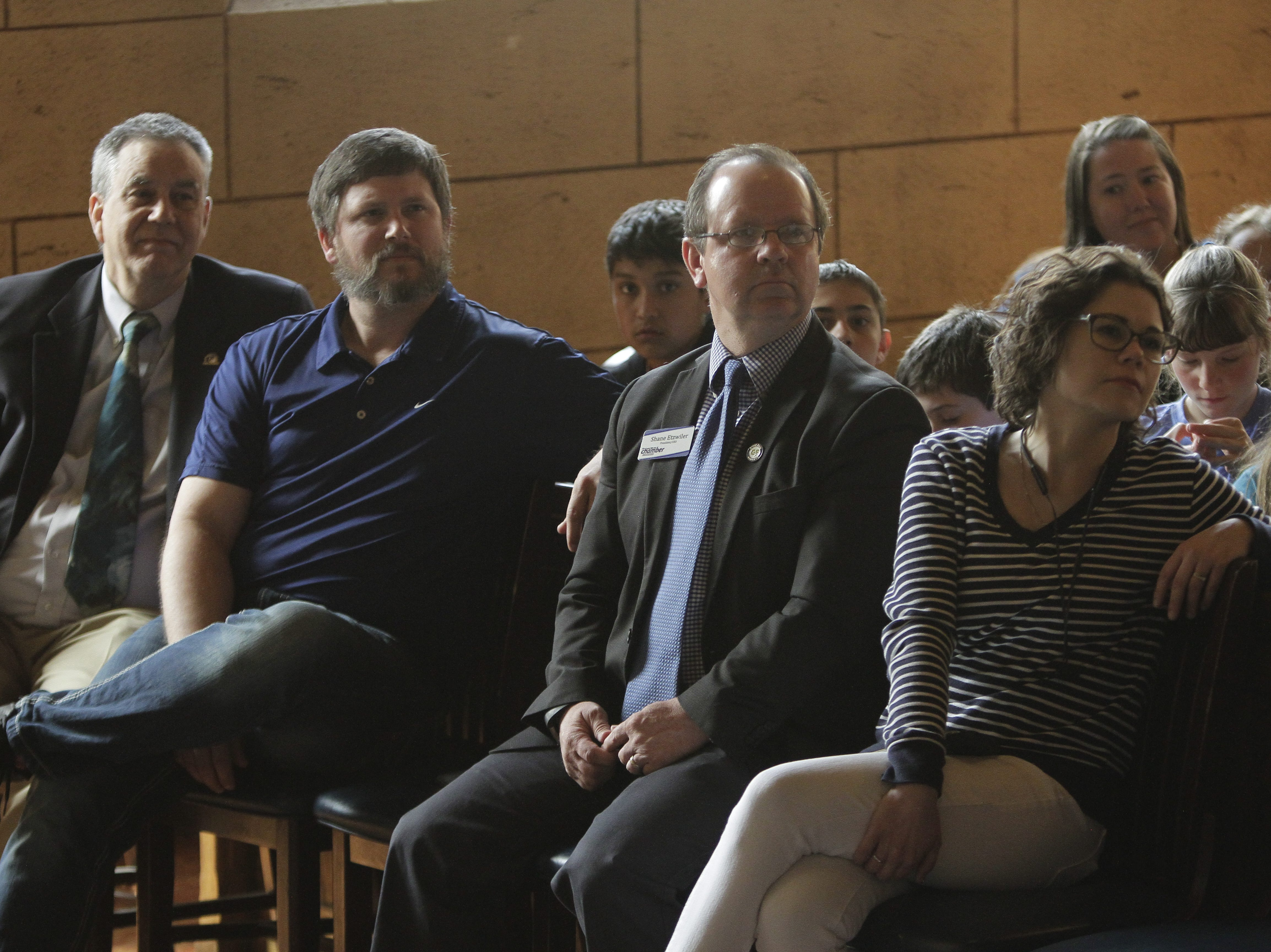 David Culpepper, Dustin Bauer, Shane Etzwiler and Teresa Schreiner watching the documentary.