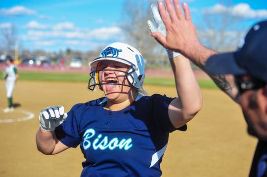 Great Falls High's Shea LaRocque celebrates driving in the go ahead run in the bottom of the sixth inning of the second crosstown softball game against CMR, Thursday at Multi-Sports Complex.