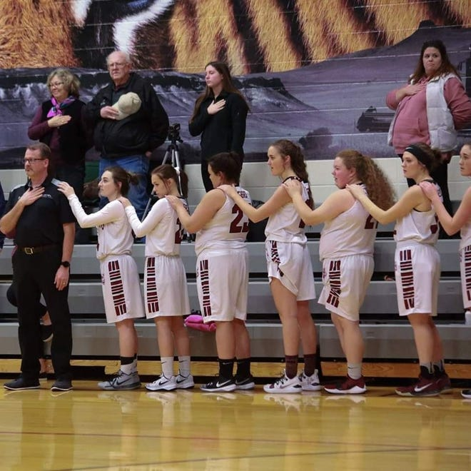 Head coach Truitt Kinna and the Simms High girls' basketball team had a fine season this past winter, finishing with a 19-4 record.