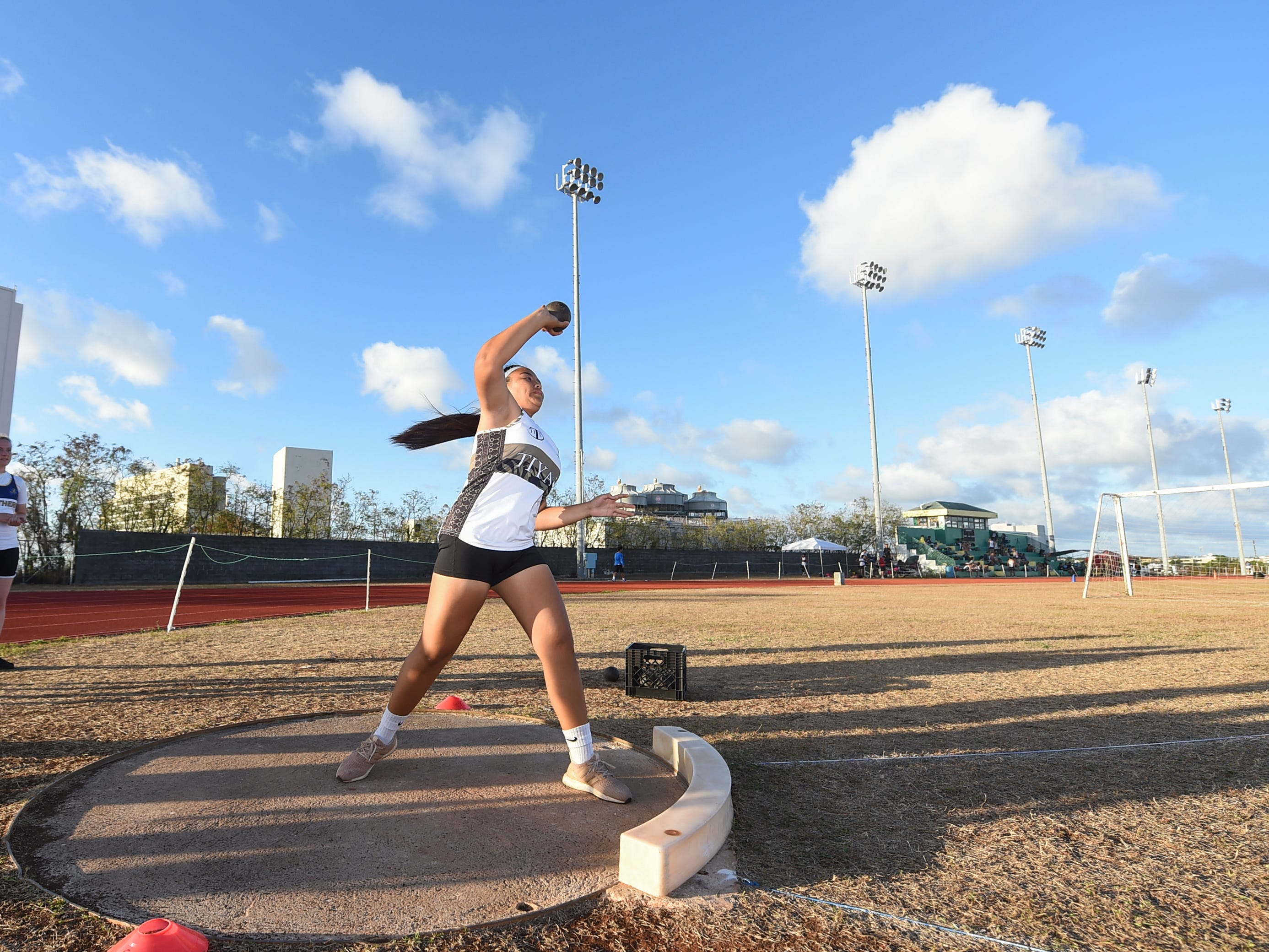 Tiyan High's Tasi Mayo, 16, competes in the Shot Put 4kg Varsity during a IIAAG Track and Field meet at John F. Kennedy Ramsey Field in Tamuning on May 10, 2019.