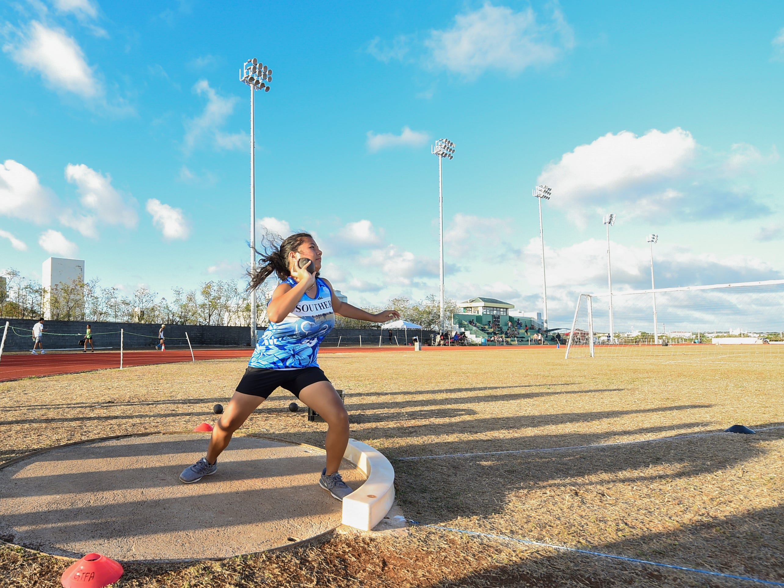 Southern High's Bailey Cruz, 17, competes in the Shot Put 4kg Varsity during a IIAAG Track and Field meet at John F. Kennedy Ramsey Field in Tamuning on May 10, 2019.