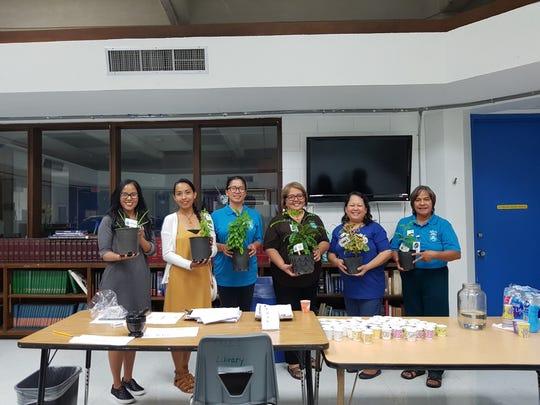 Pictured from left: Sinora Loretta P. Cruz, Sinorita Eva A. Cruz, Clarissa Torres, Yo'amte; Zita Pangelinan, president, Haya Foundation; Sinora LeVonne S. Mantanona and Susan Aguon, Yo'amte.