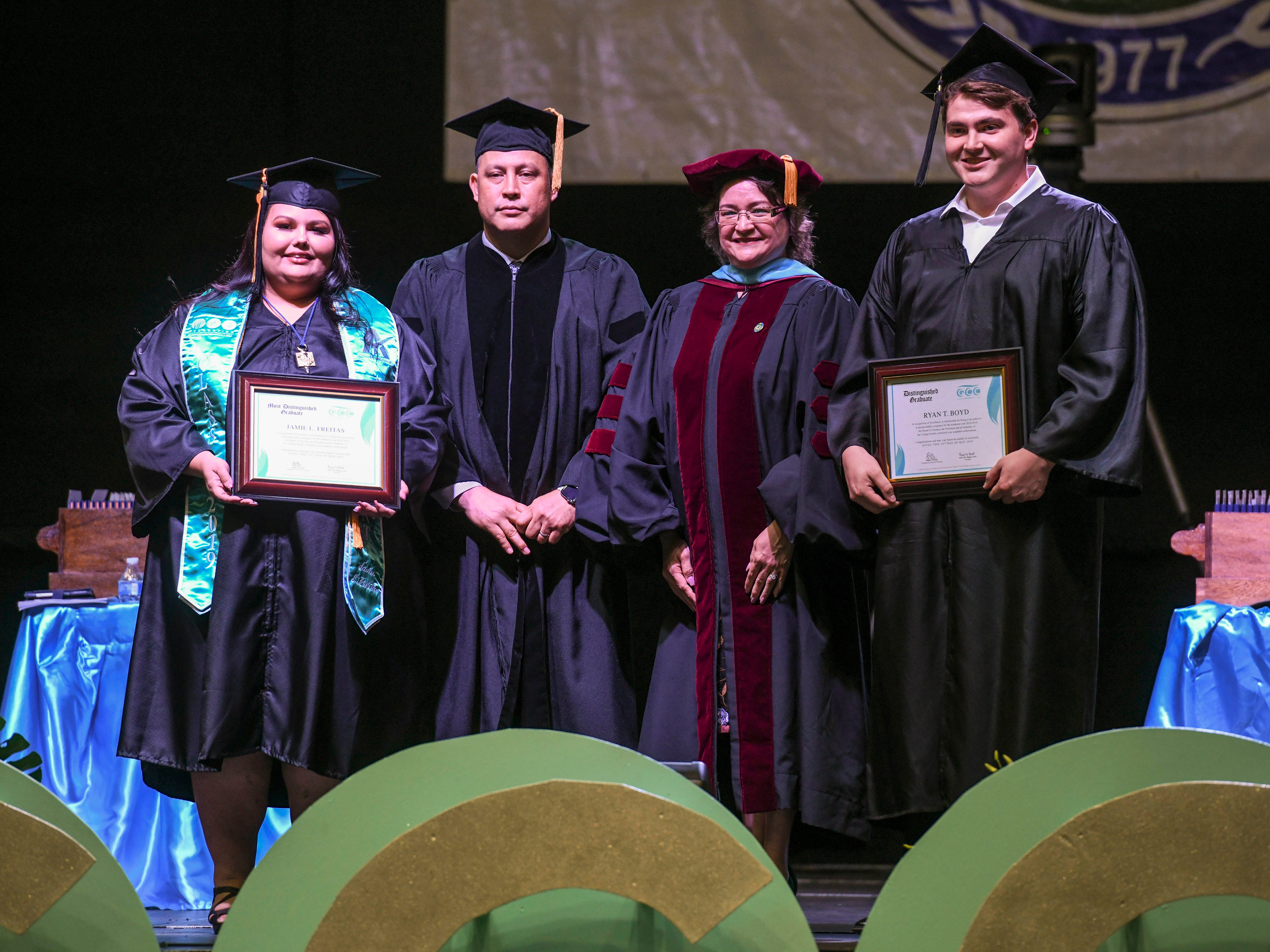 Jaime Lynn Freitas, left, is recognized as the most distinguished graduate and Ryan Boyd as the distinguished graduate during Guam Community College's commencement exercise at the University of Guam in Mangilao on Friday, May 10, 2019. The college conferred a total of 435 degrees, certificates, and/or diplomas to 357 graduate celebrated at the ceremony, attended by hundreds of family members, friends and other well wishers.