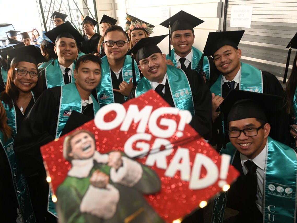 Students from the Guam Community College pose for a picture at their graduation ceremony on May 11, 2019.