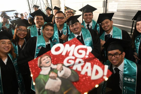 Students from the Guam Community College pose for a picture at their graduation ceremony in this  May 11, 2019, file photo.