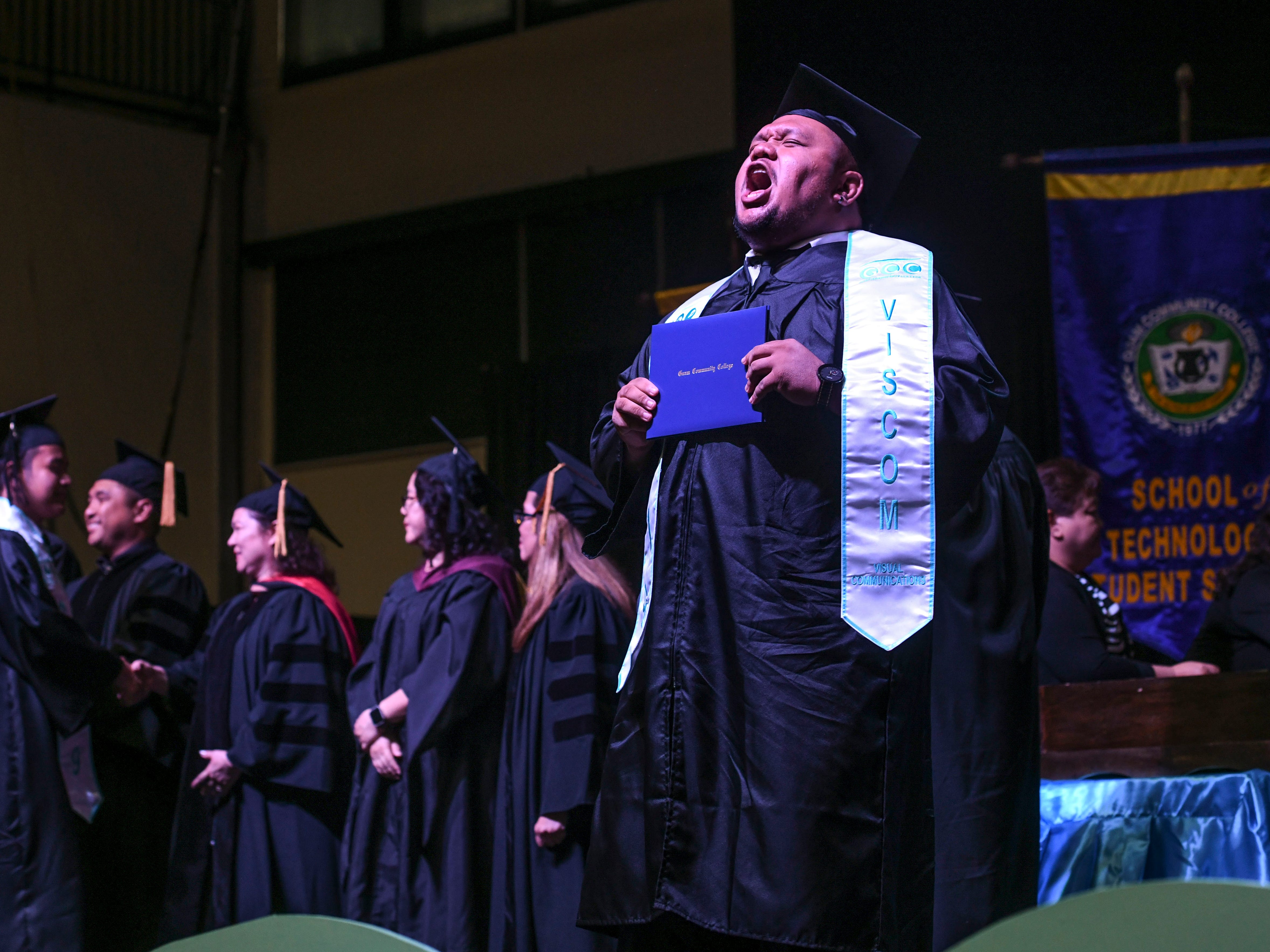 A graduate celebrates a little after receiving his certification or diploma during the Guam Community College's 2019 commencement exercise at the University of Guam in Mangilao on Friday, May 10, 2019. The college conferred a total of 435 degrees, certificates, and/or diplomas to 357 graduates at the event attended by hundreds of family members, friends and other well wishers.