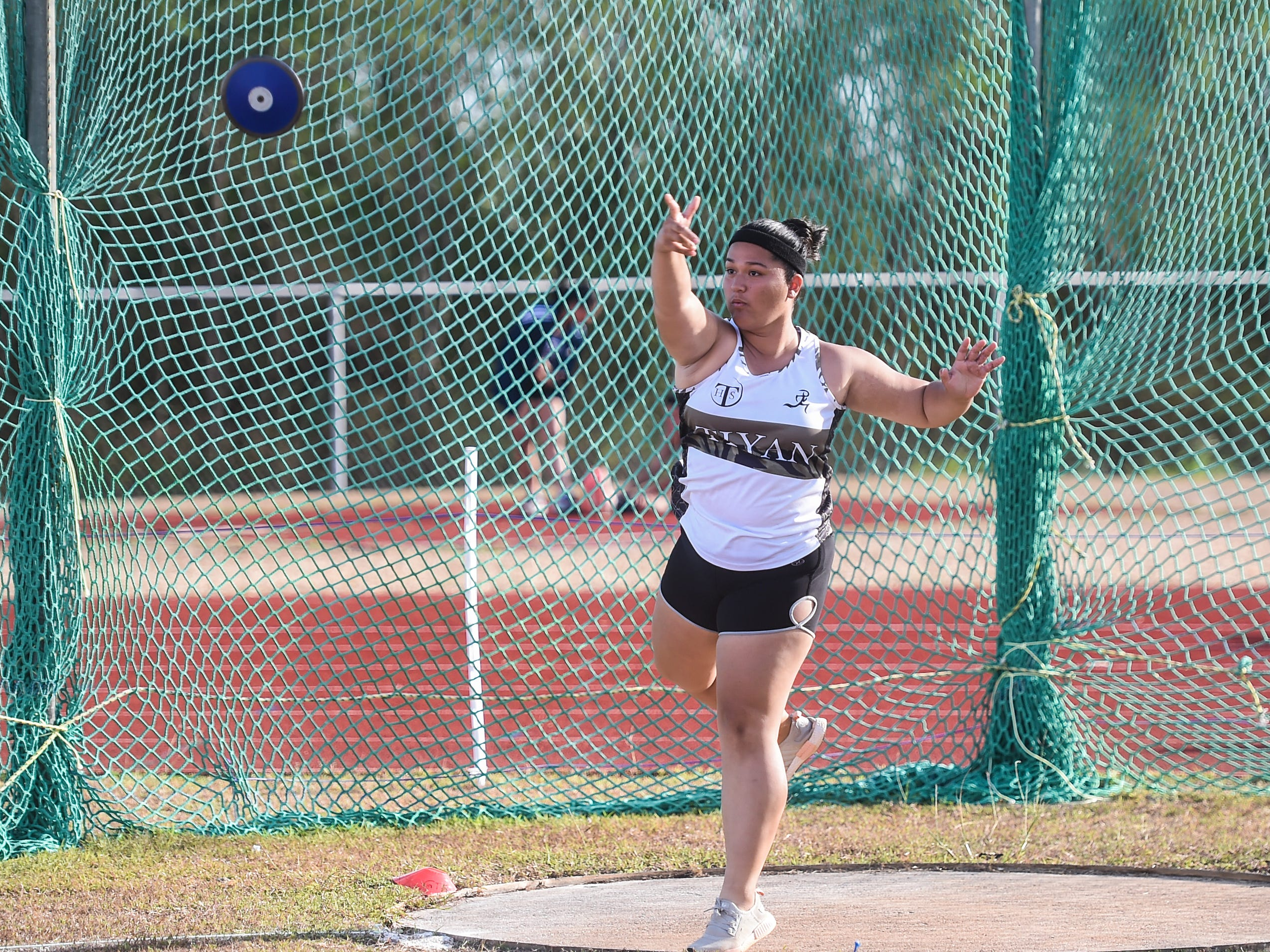 Tiyan High's Reniah Ungacta, 18, competes in the 1kg Discus Varsity during a IIAAG Track and Field meet at John F. Kennedy Ramsey Field in Tamuning on May 10, 2019.