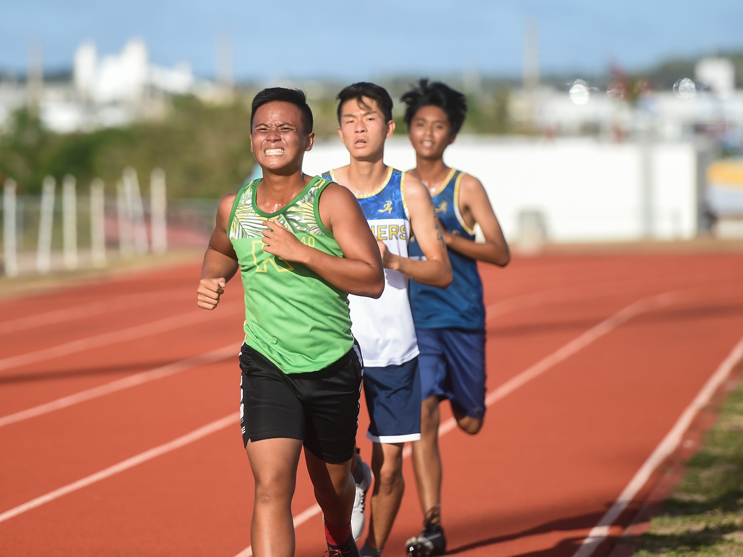 Athletes race in the Men's 3000 Meter Varsity event during a IIAAG Track and Field meet at John F. Kennedy Ramsey Field in Tamuning on May 10, 2019.