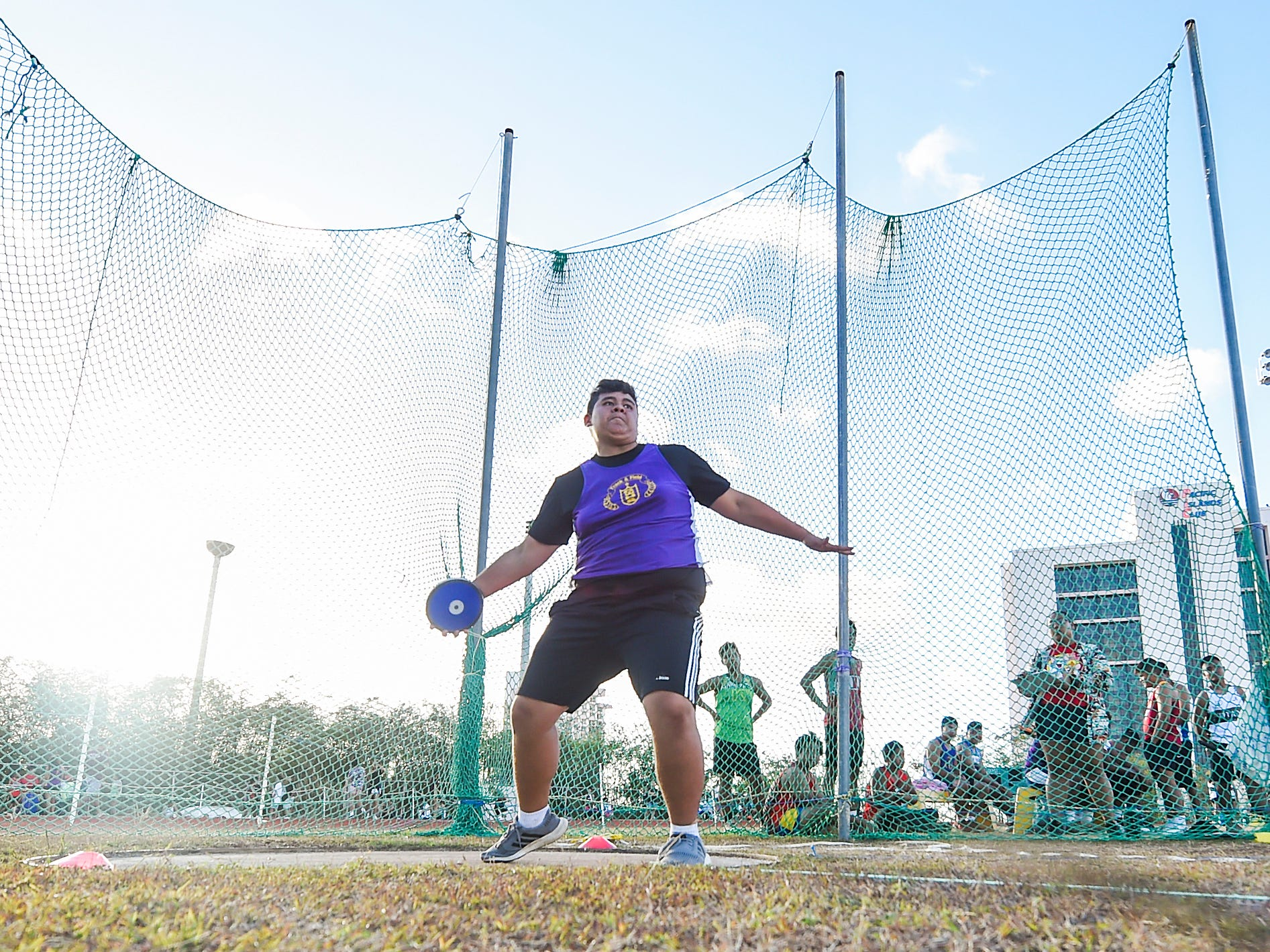 George Washington's Jeremiah Mafnas, 16, competes in the Discus 1.6kg Varsity during a IIAAG Track and Field meet at John F. Kennedy Ramsey Field in Tamuning on May 10, 2019.