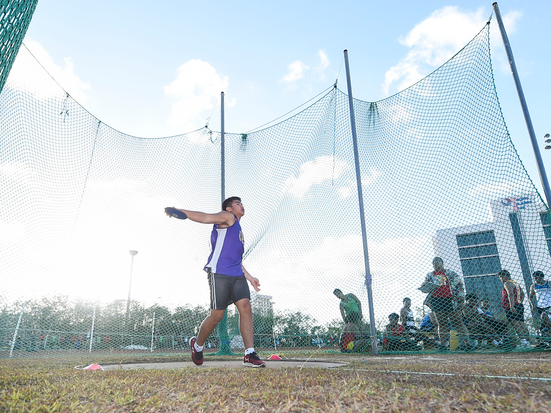 George Washington's Mykai Blas, 15, competes in the Discus 1.6kg Varsity during a IIAAG Track and Field meet at John F. Kennedy Ramsey Field in Tamuning on May 10, 2019.