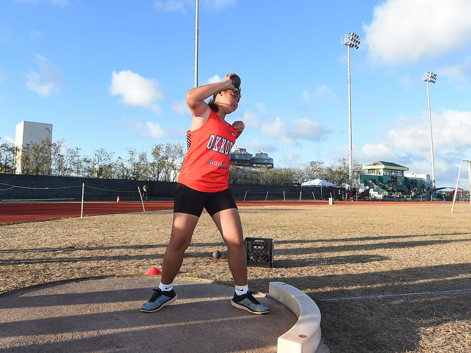 Okkodo High athlete Althea Ocampo, 15, prepares to make a release in the Shot Put 4kg Varisty event during a IIAAG Track and Field meet at John F. Kennedy Ramsey Field in Tamuning on May 10, 2019.